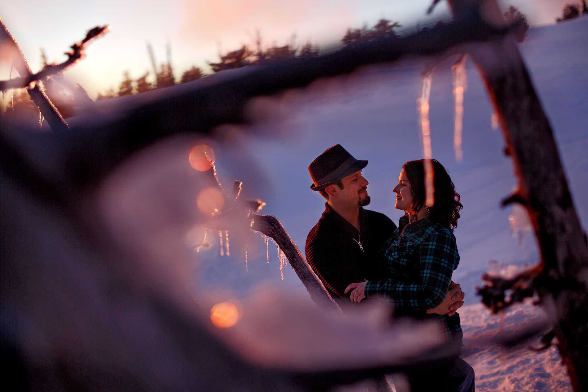 Beautiful purple light on engaged couple atop Mt Hood at Timberline Lodge