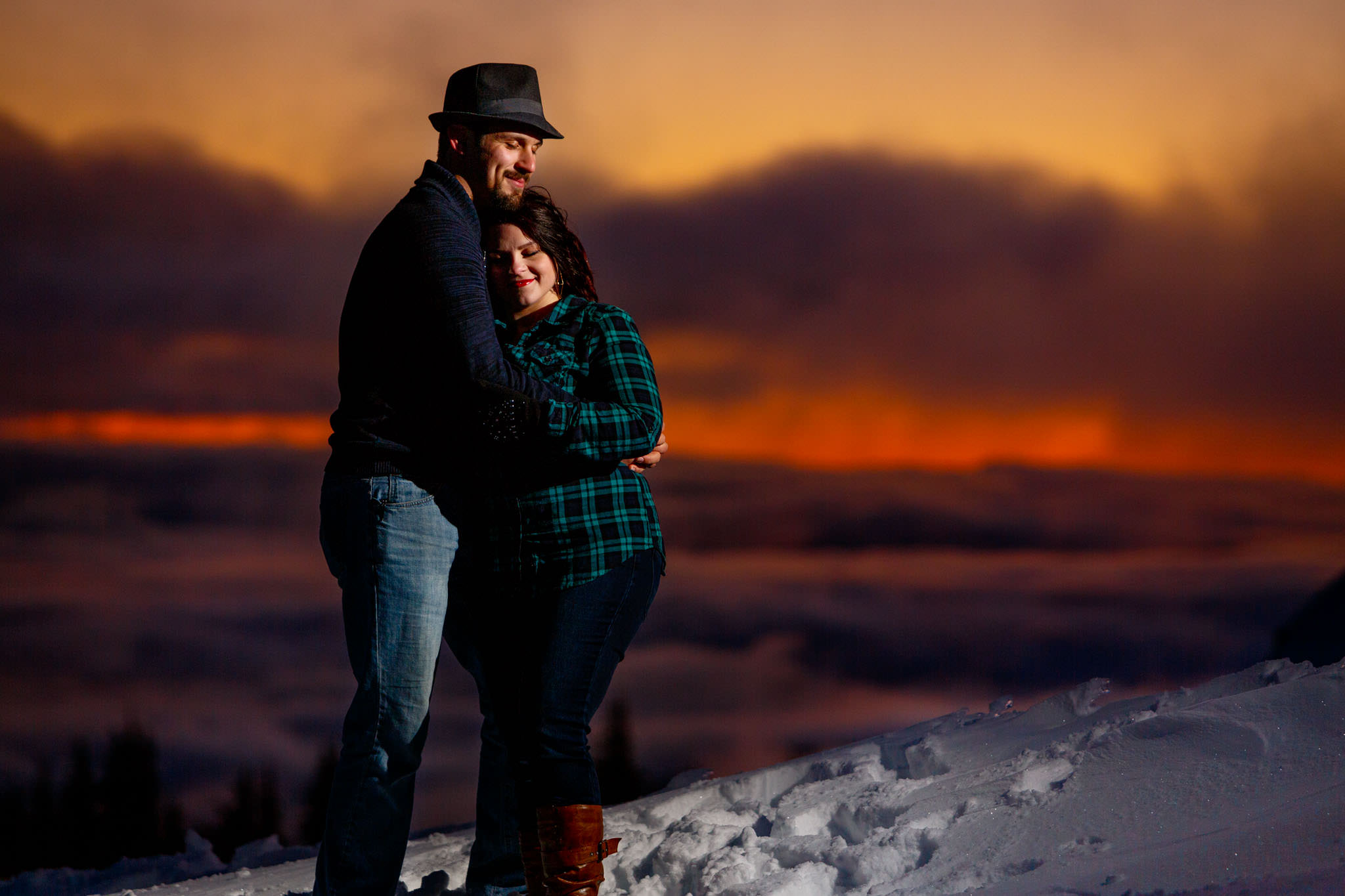 Red orange sunset with engaged couple atop Mt Hood at Timberline Lodge