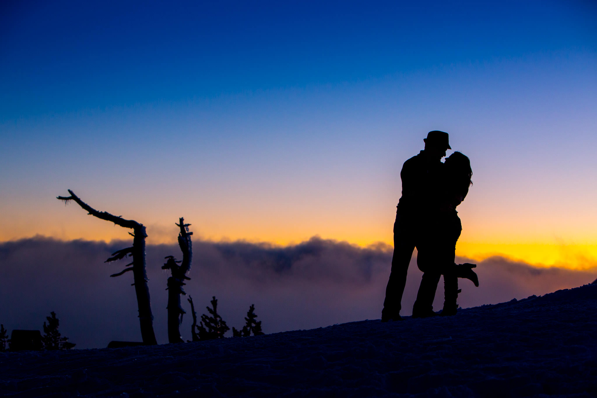 Beautiful sunset with engaged couple atop Mt Hood at Timberline Lodge