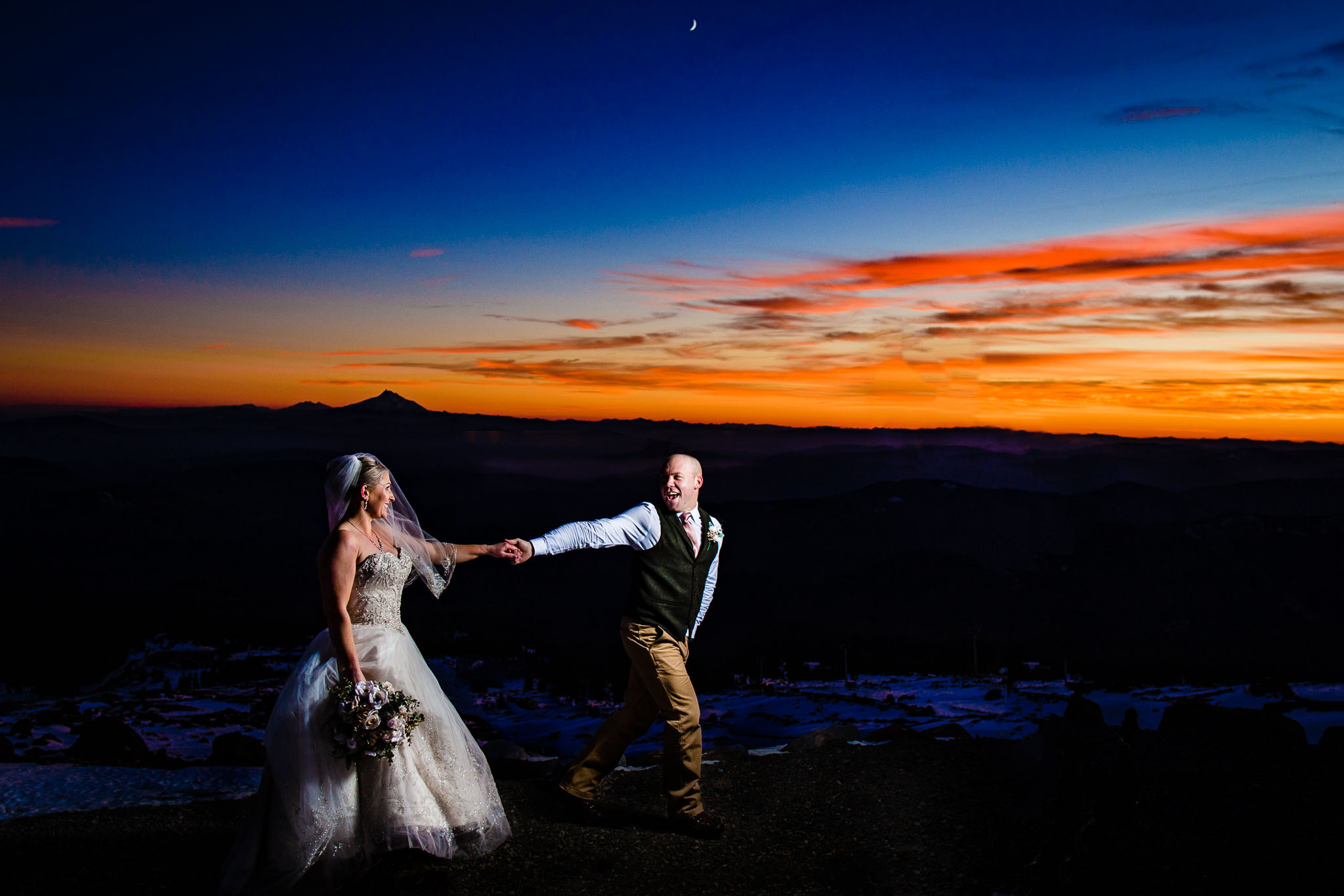 Epic sunset photo of bride and groom atop Mt Hood at Silcox Hut above Timberline Lodge JOS studios