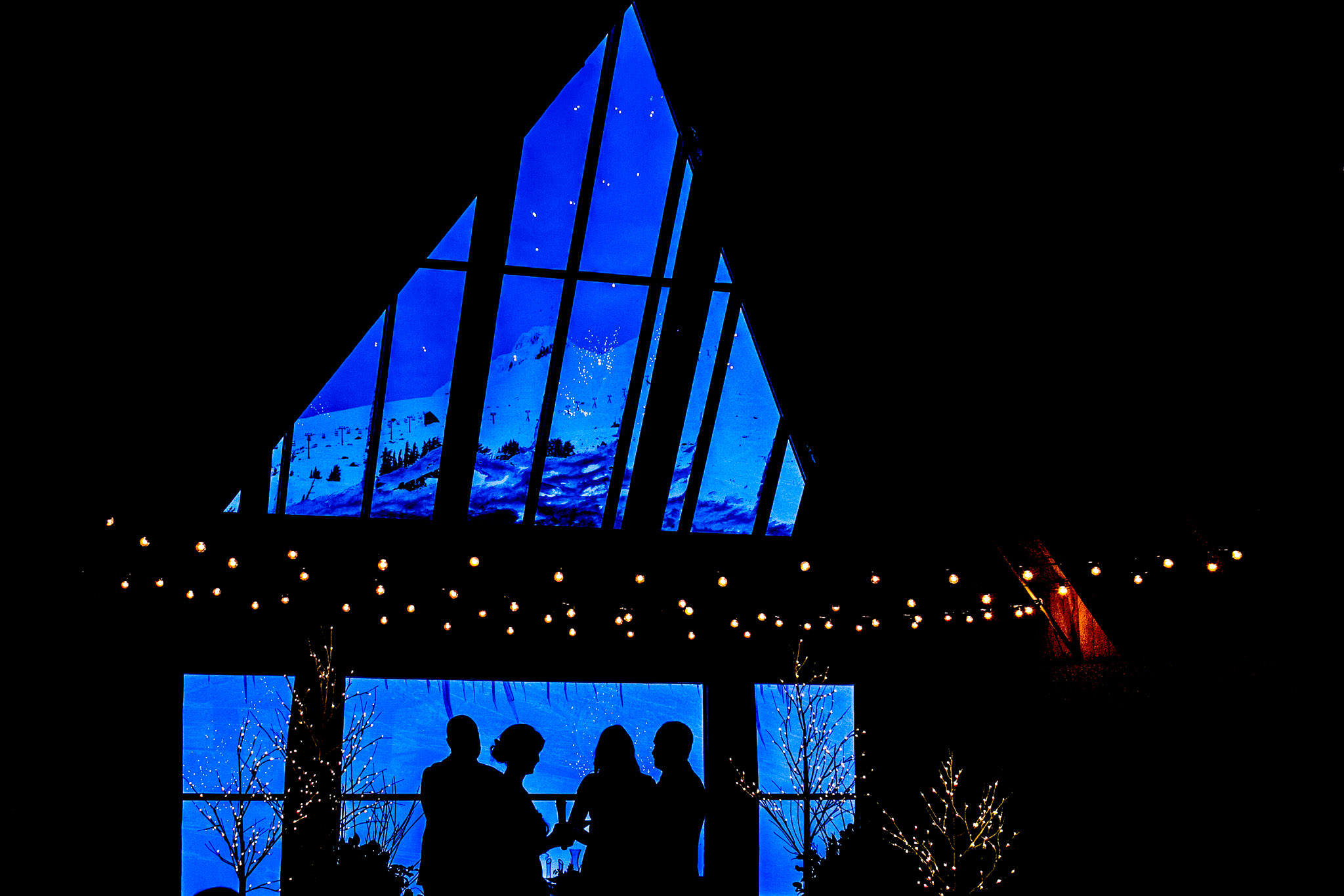 Wedding ceremony at Timberline Lodge in Eagles Nest - Silhouette shot of bride and groom in ceremony