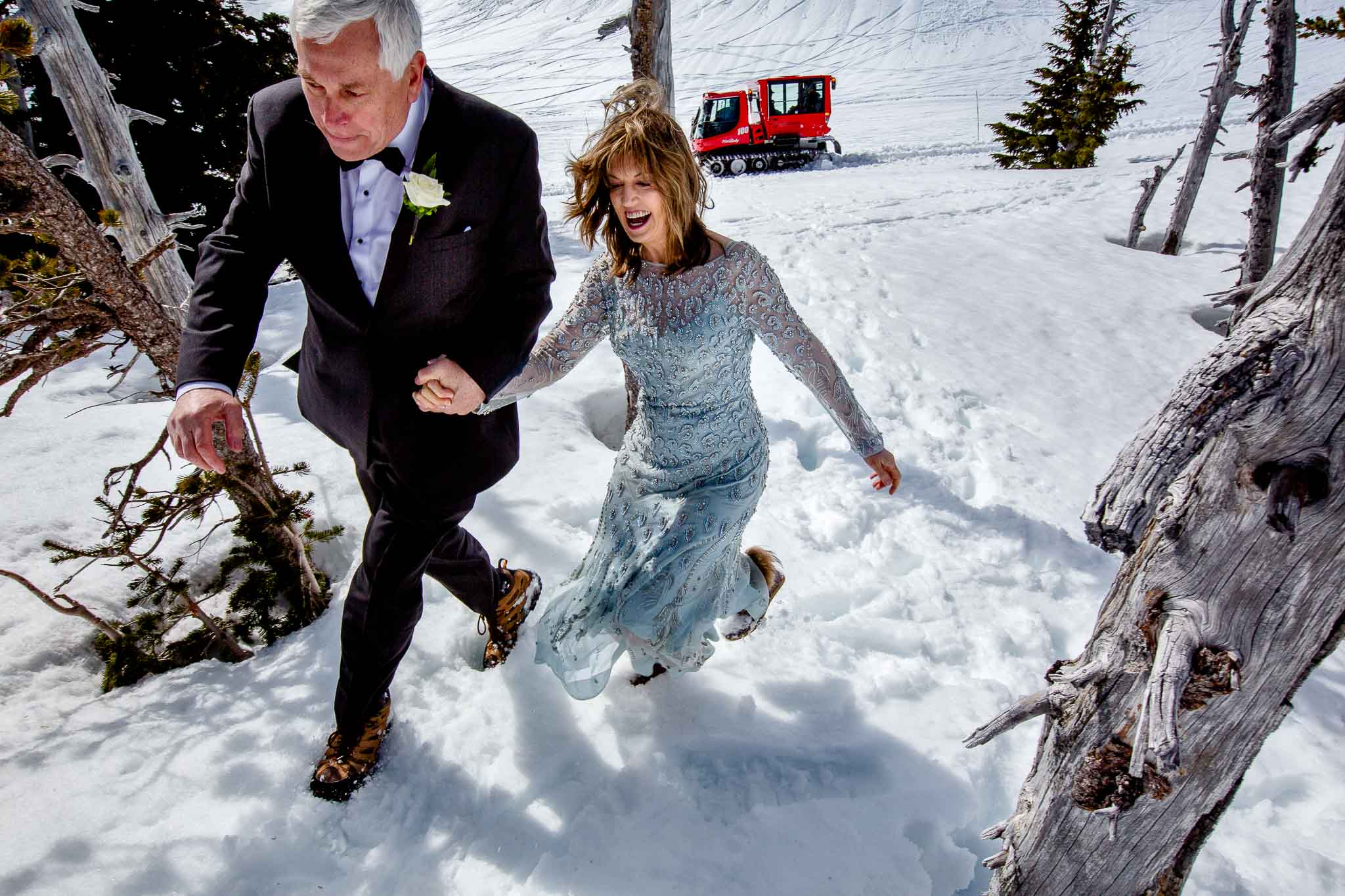 Timberline Lodge Wedding Couple Running through snow