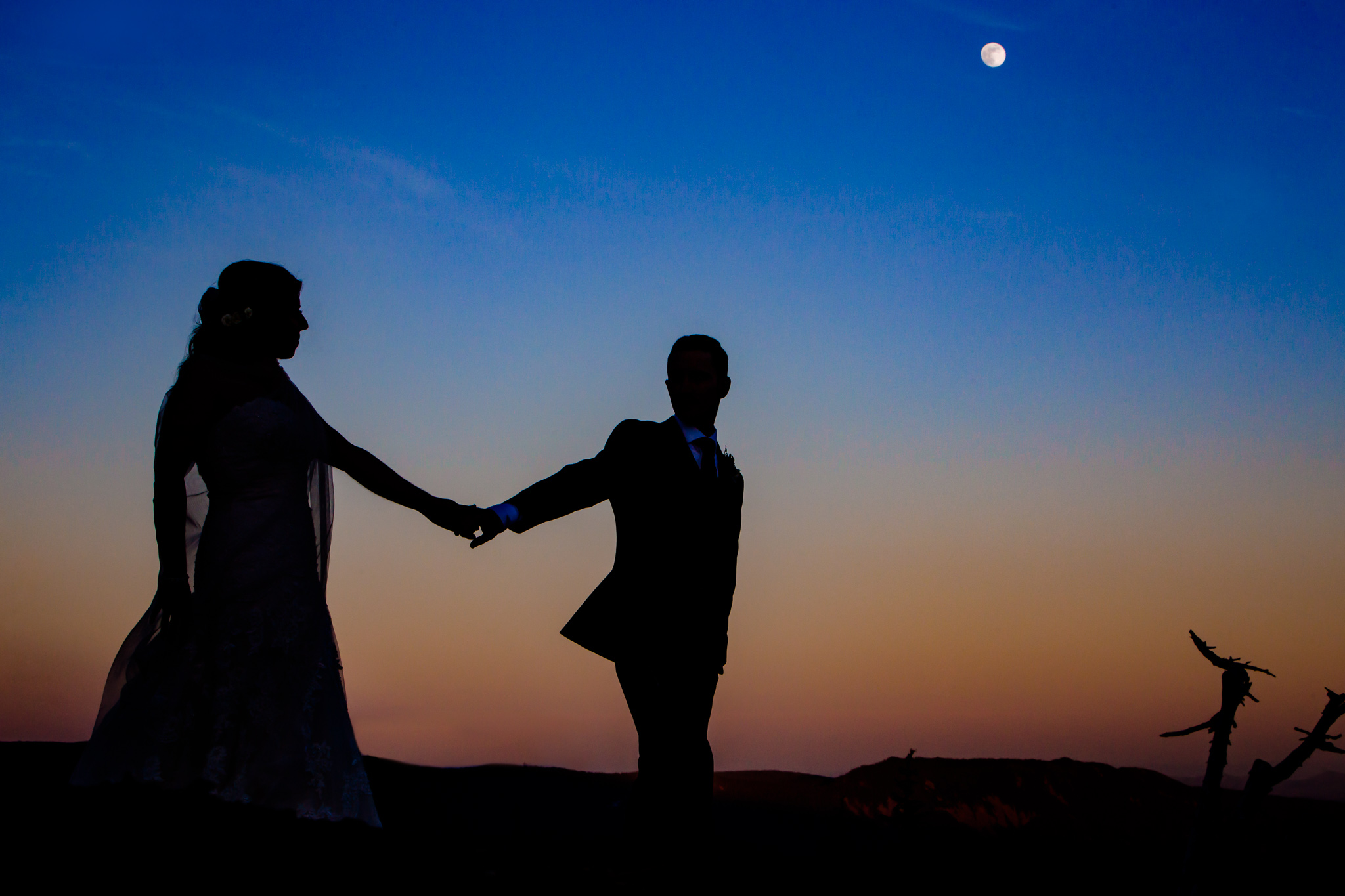 Beautiful moon rise at Timberline Lodge with Wedding Couple