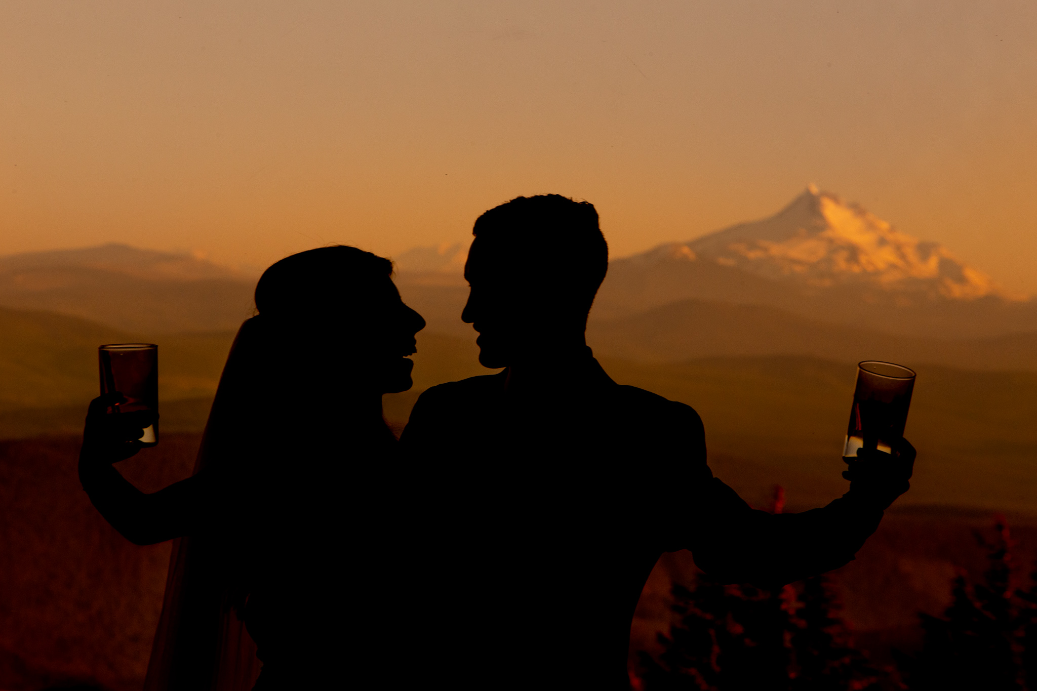 Bride and Groom Cheers at Sunset Timberline Lodge