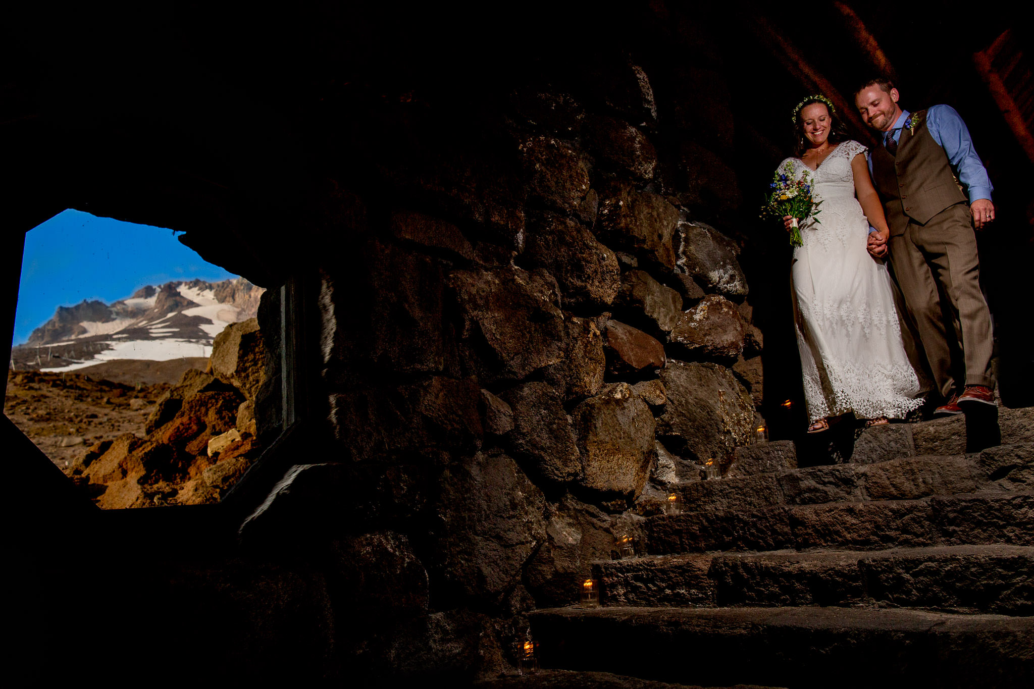 Bride and groom exiting Silcox Hut ceremony down stone staircase