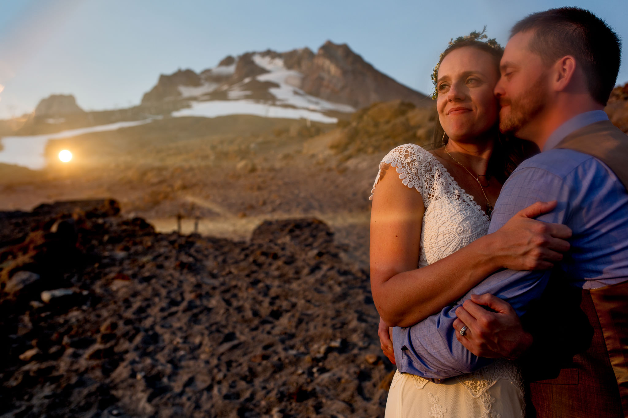 Bride and Groom looking out over valley atop Mt Hood above Timberline Lodge