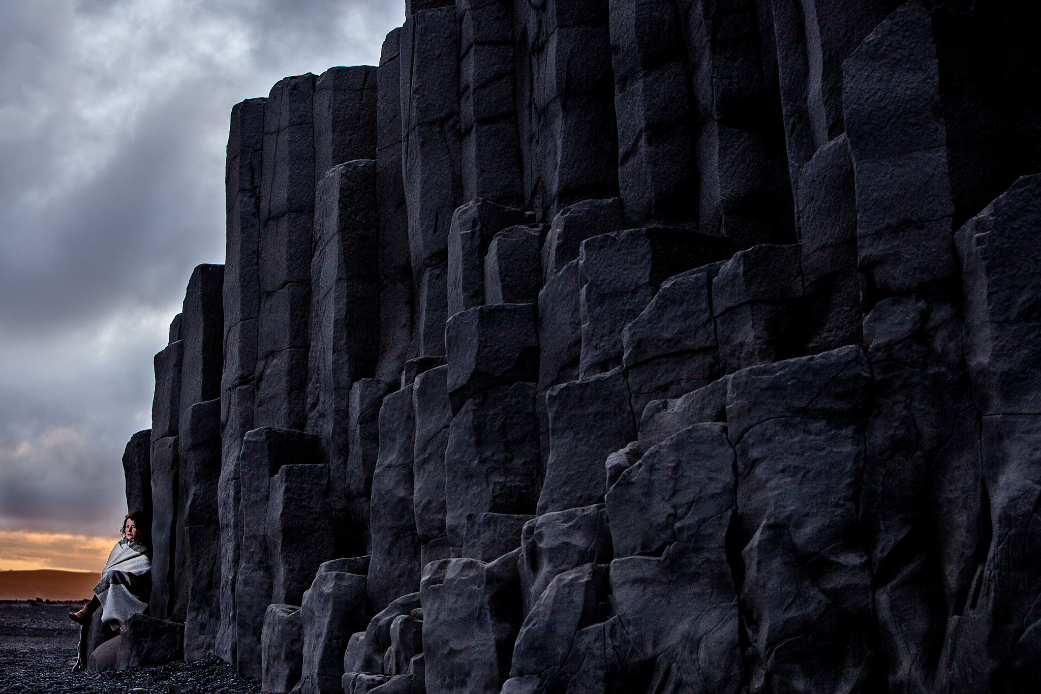 Woman against stone wall in Vic Iceland where Game of Thrones was filmed