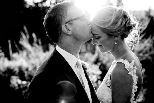 Sun flare photo of bride and groom at Mt Hood Organic Farms