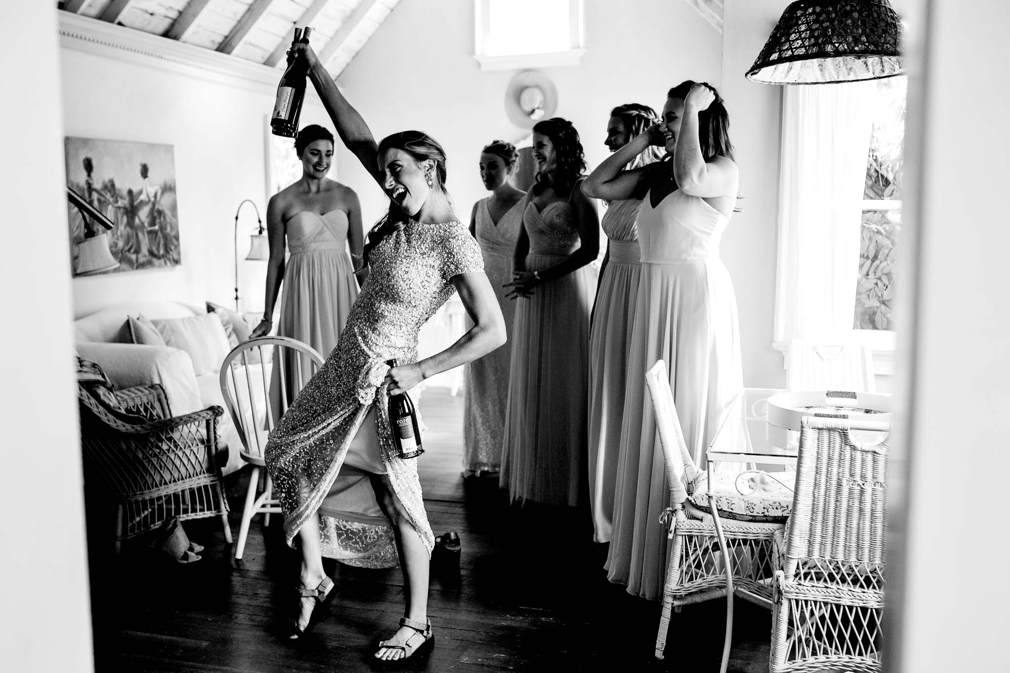 Bridesmaids celebrating while getting ready at Mt Hood Organic Farms