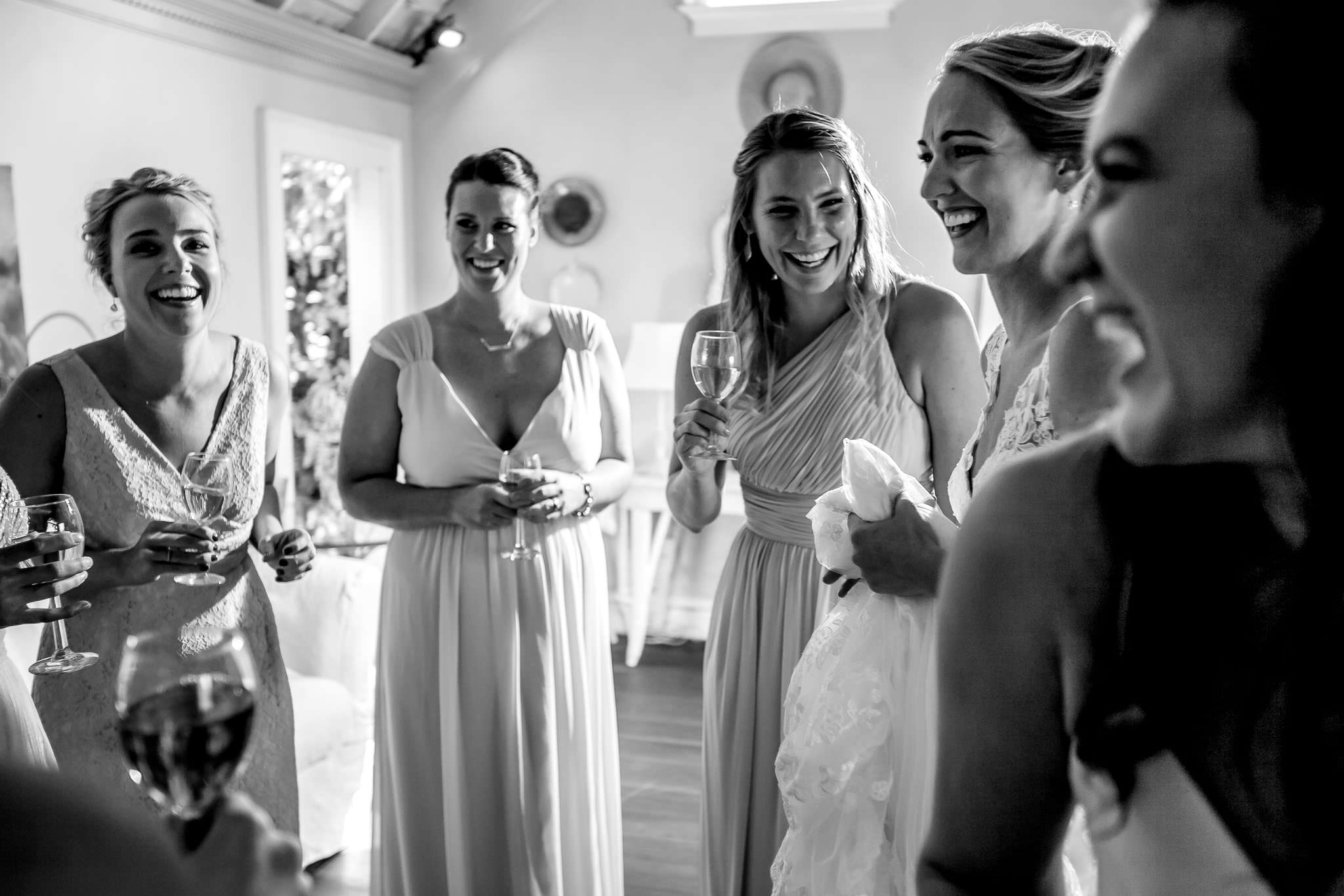 Bridesmaids laughing together while bride gets ready at Mt Hood Organic Farms
