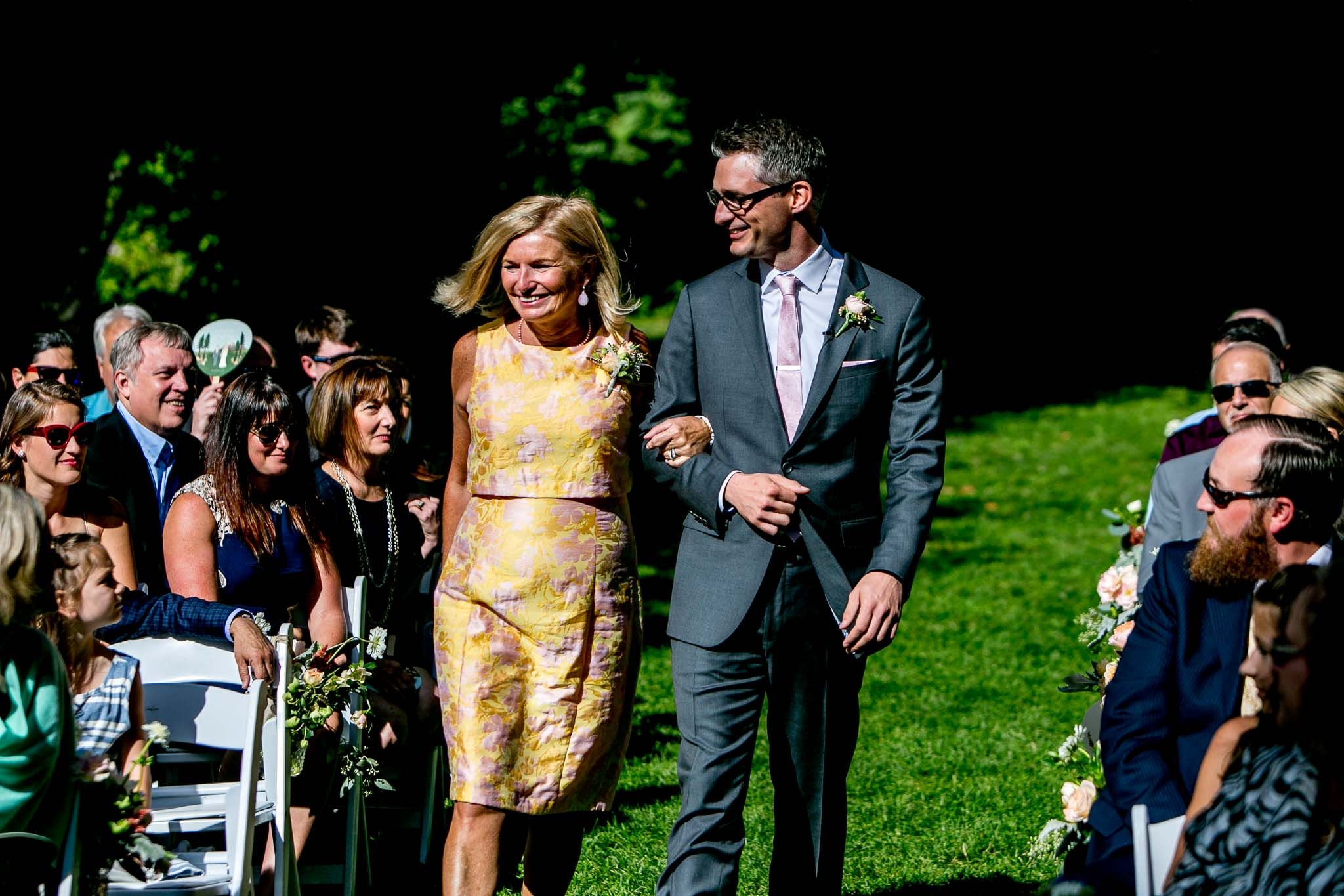 Groom and mother walking down isle at Mt Hood Organic Farms