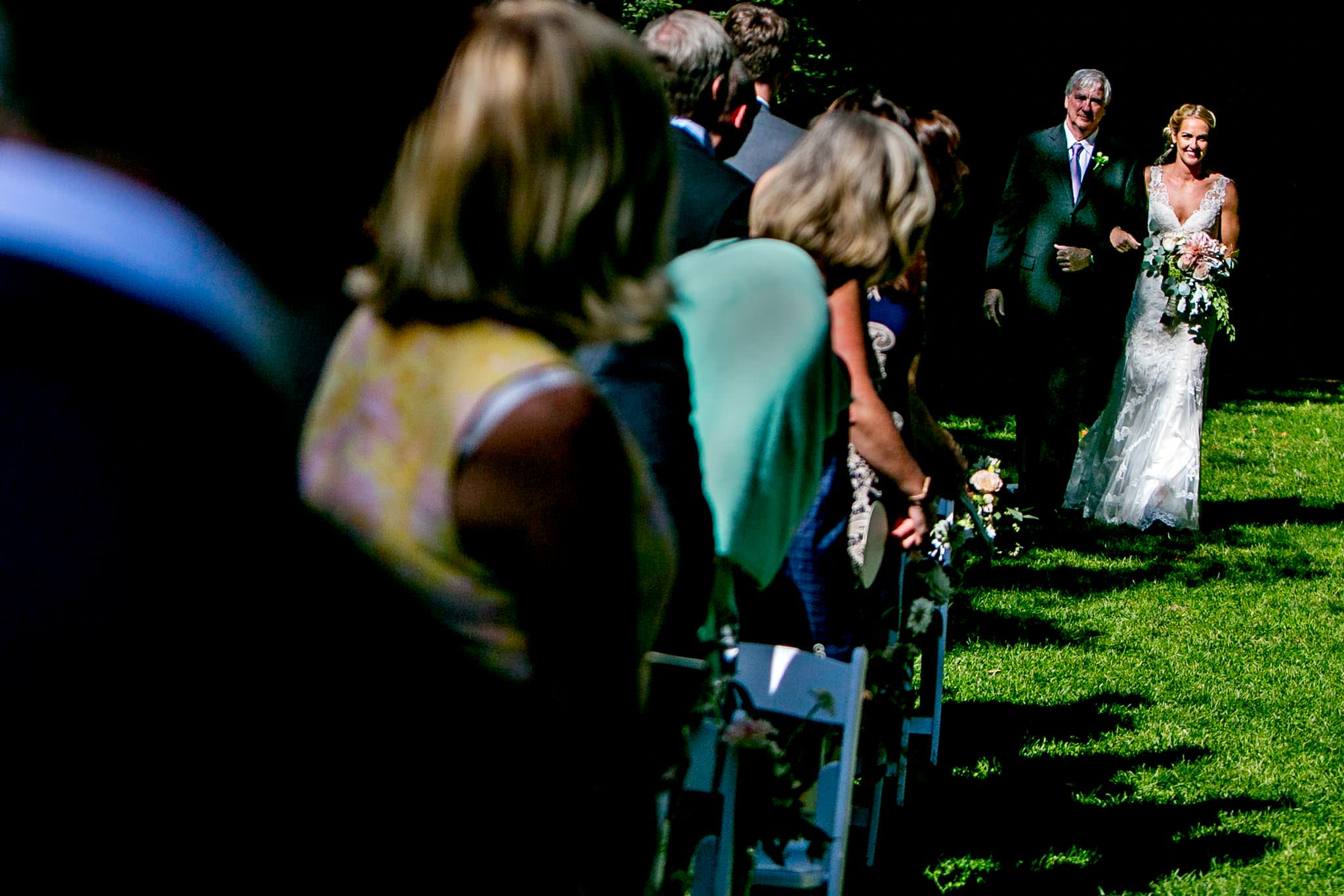 Bride and Father walking down isle at Mt Hood Organic Farms