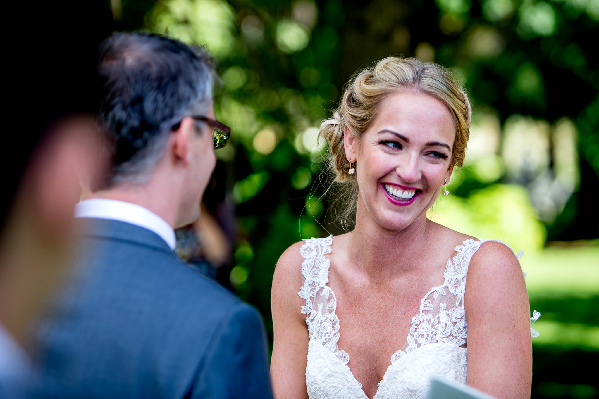 Bride laughing during ceremony at Mt Hood Organic Farms