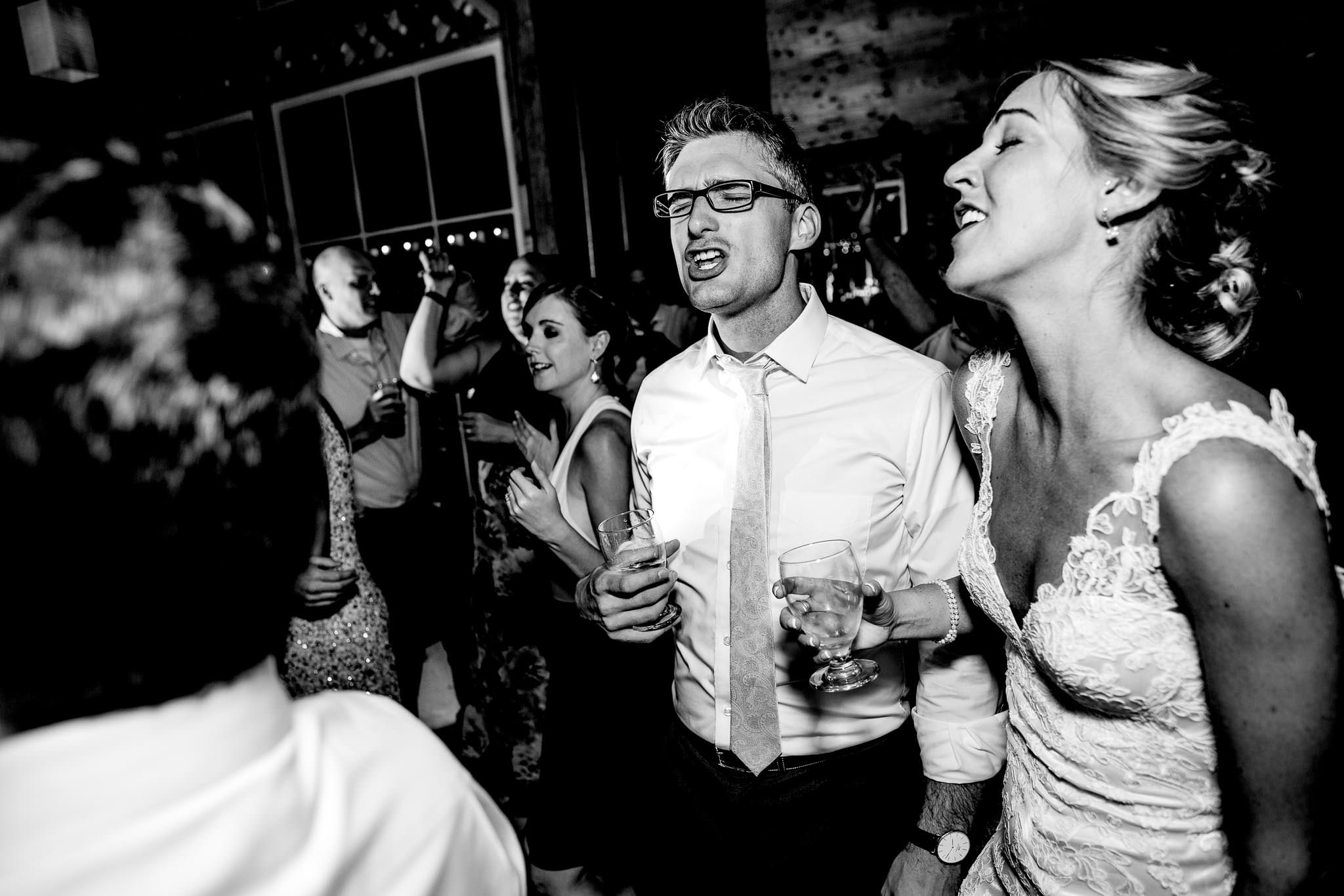 Bride and groom laughing and dancing with friends at Mt Hood Organic Farms
