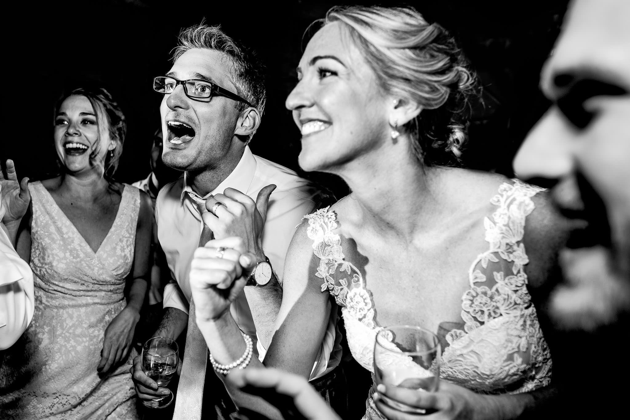 Bride and groom laughing and dancing with friends at Mt Hood Organic Farms reception