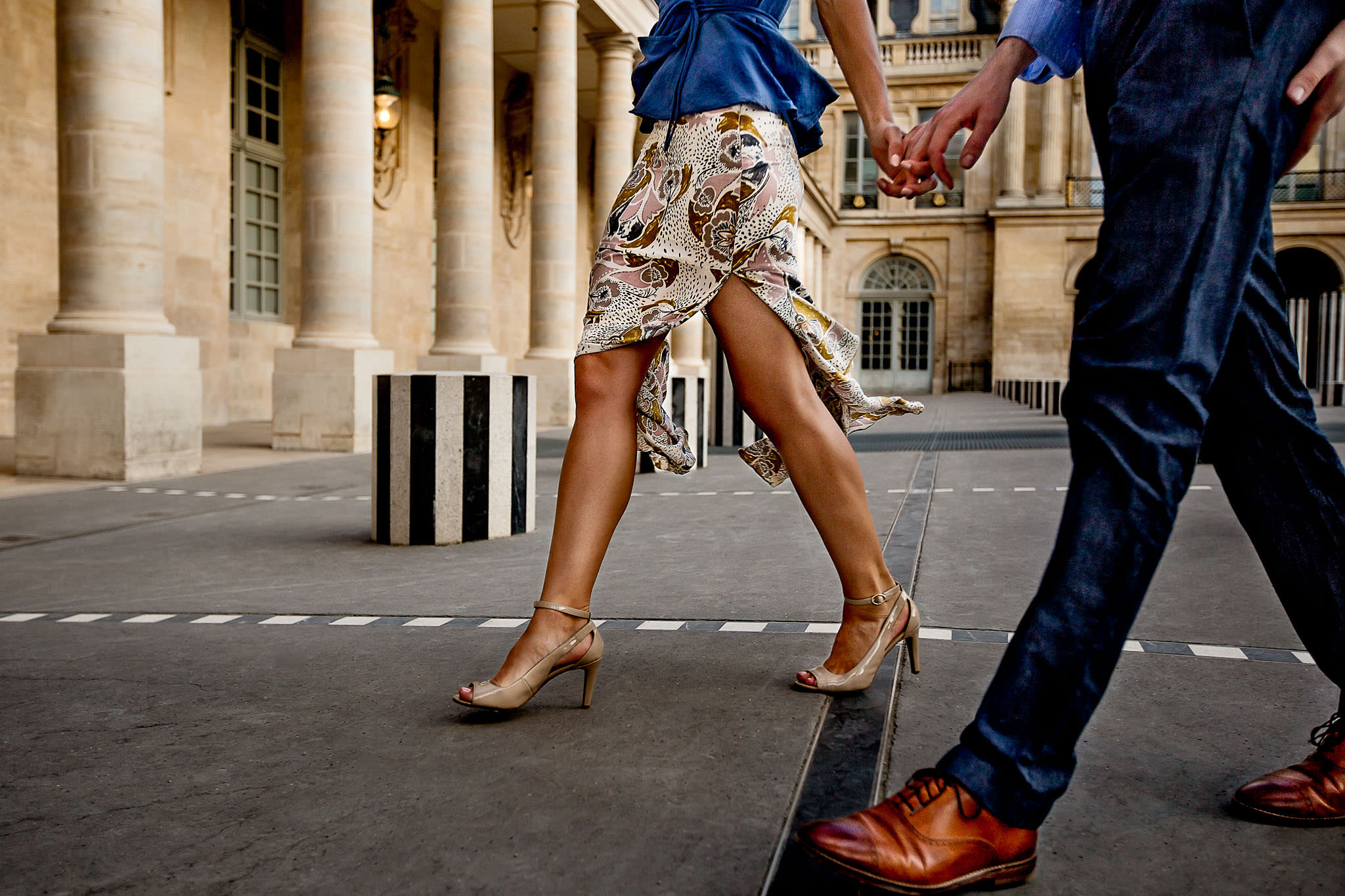 Engagement photo in Paris with couple walking