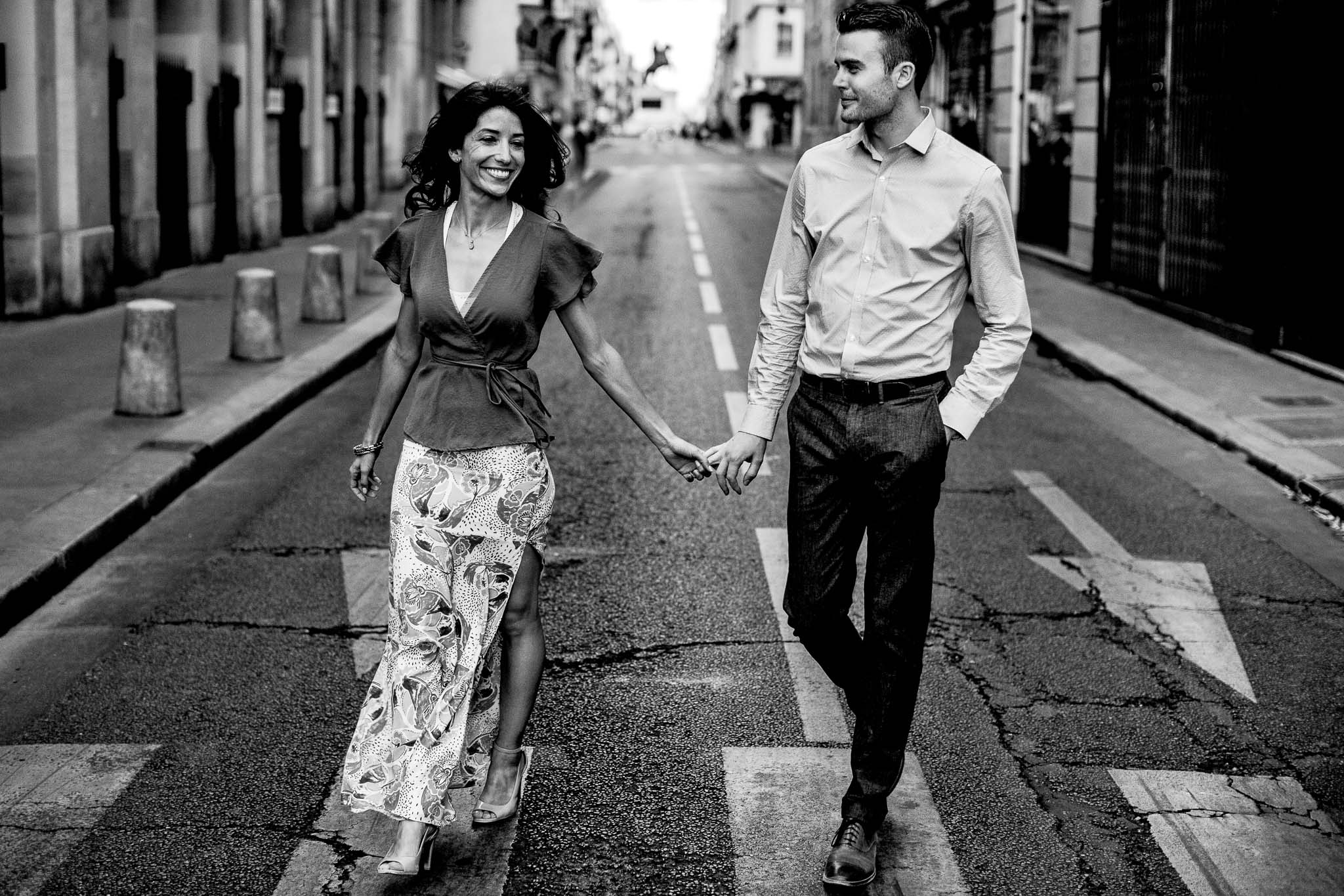 Engagement photo in Paris while walking and laughing
