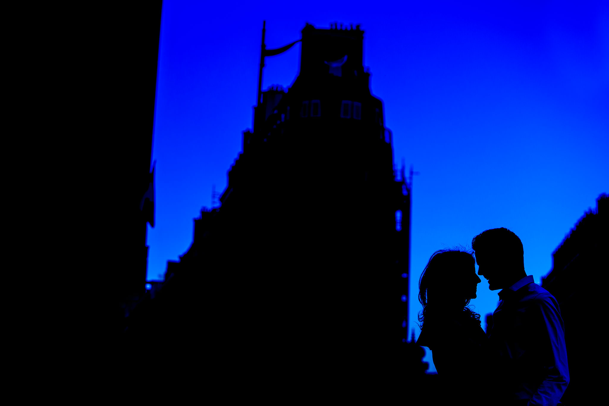 Engagement photo in Paris just after sunset with blue sky