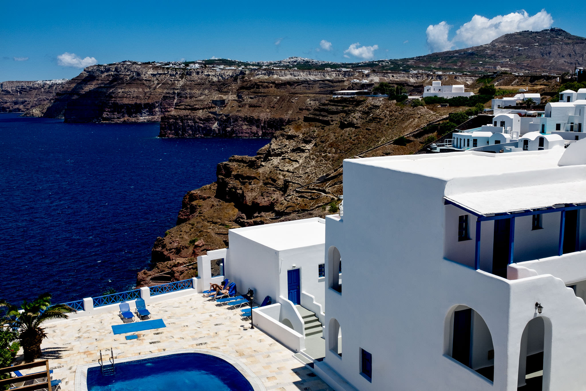 Beautiful White Wash Greek homes overlooking Santorini Greece ocean