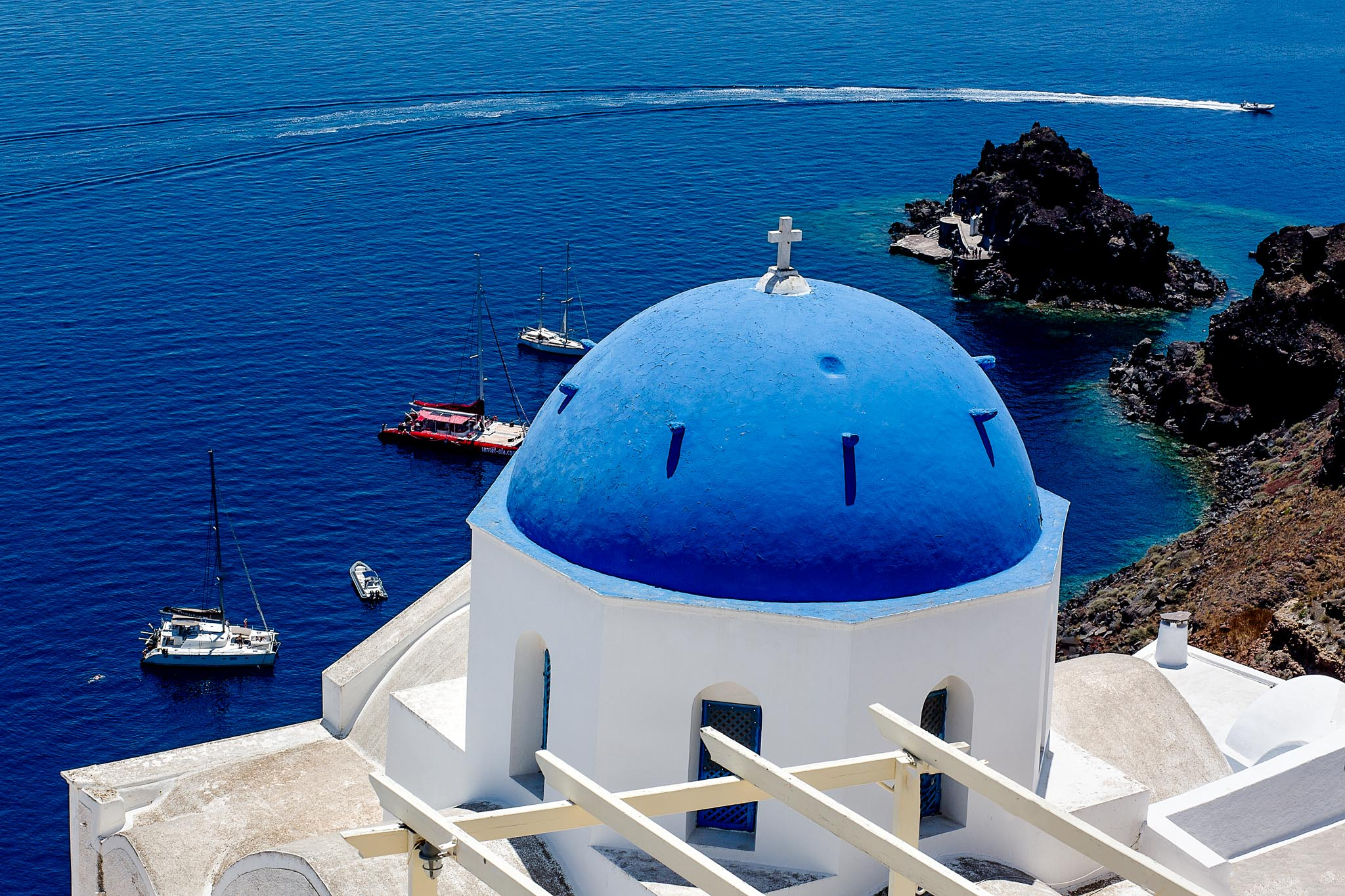 Santorini blue dome church rooftop over ocean