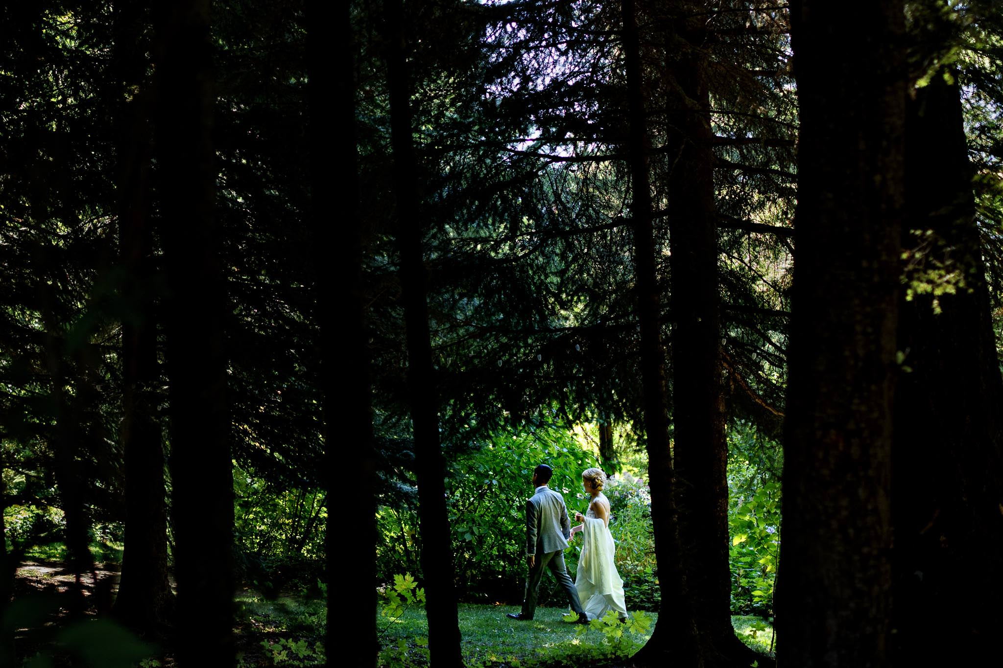 Bride and Groom walking through forest at Mt Hood Organic Farms