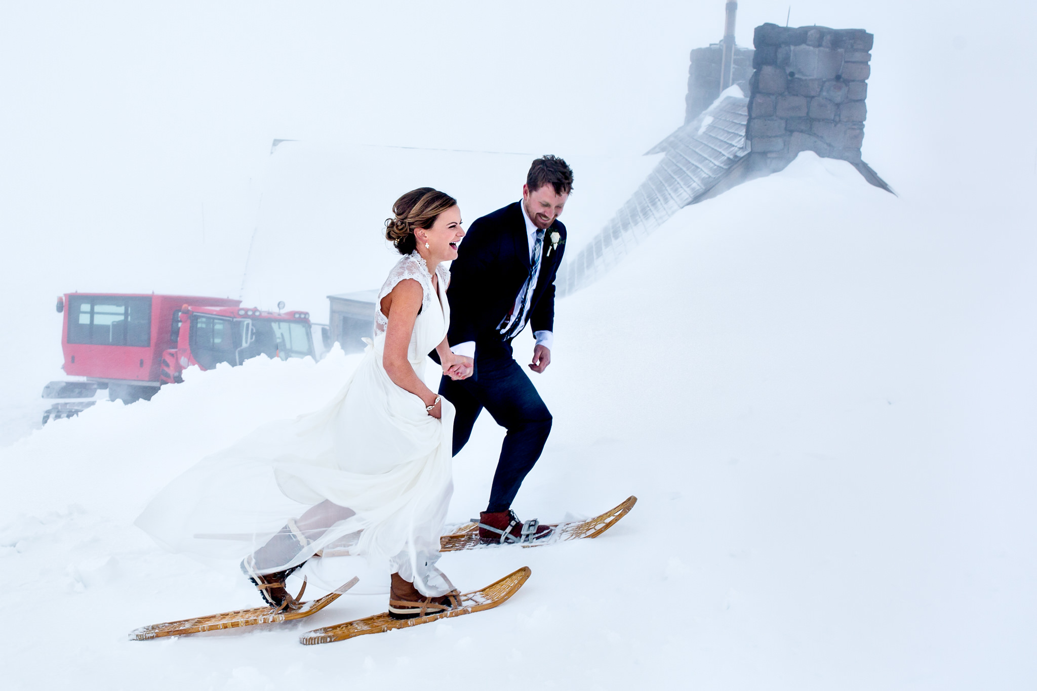 Bride and groom snow shoeing atop Mt Hood at Timberline Lodge