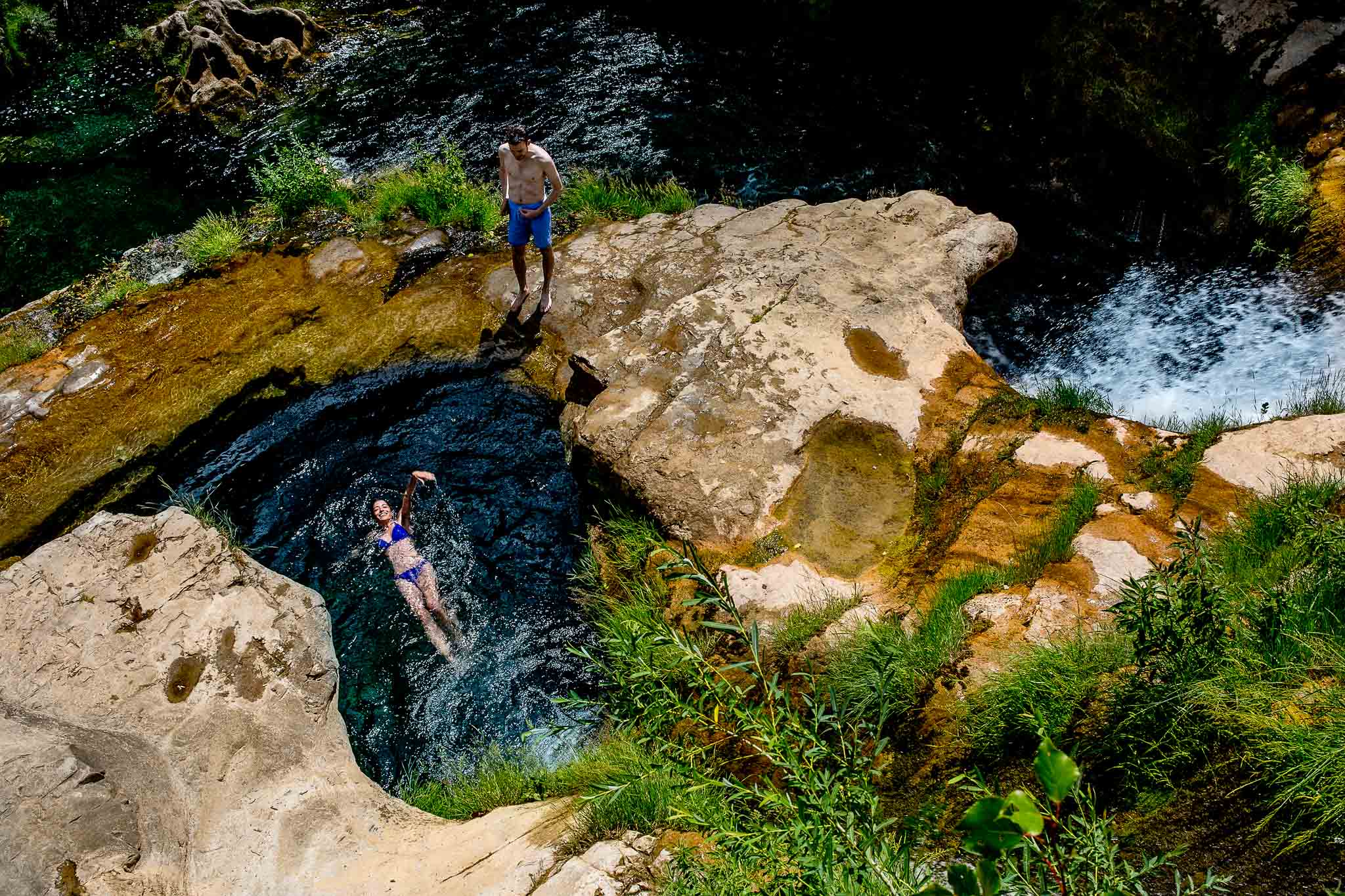 Bride swimming in river pool in Cirque de Navacelles outside Montpellier France