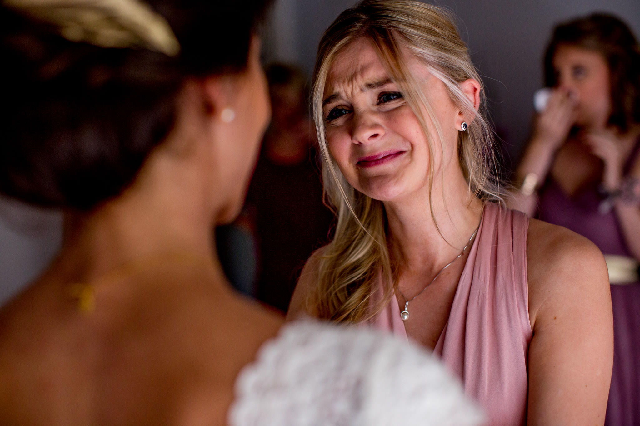 Emotional bridesmaid with bride in Cirque de Navacelles outside Montpellier France