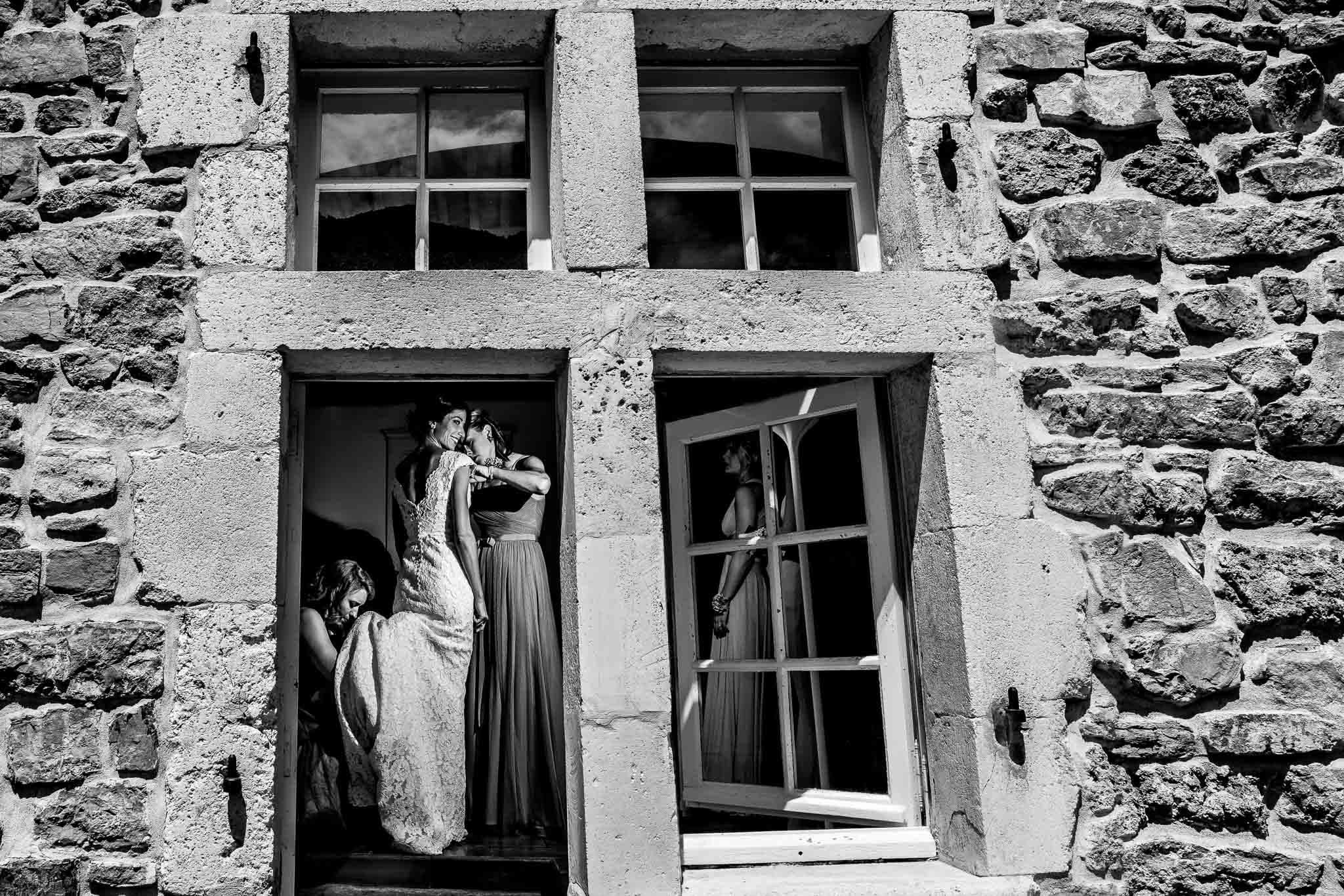 Bride getting dress on through window in Cirque de Navacelles outside Montpellier France
