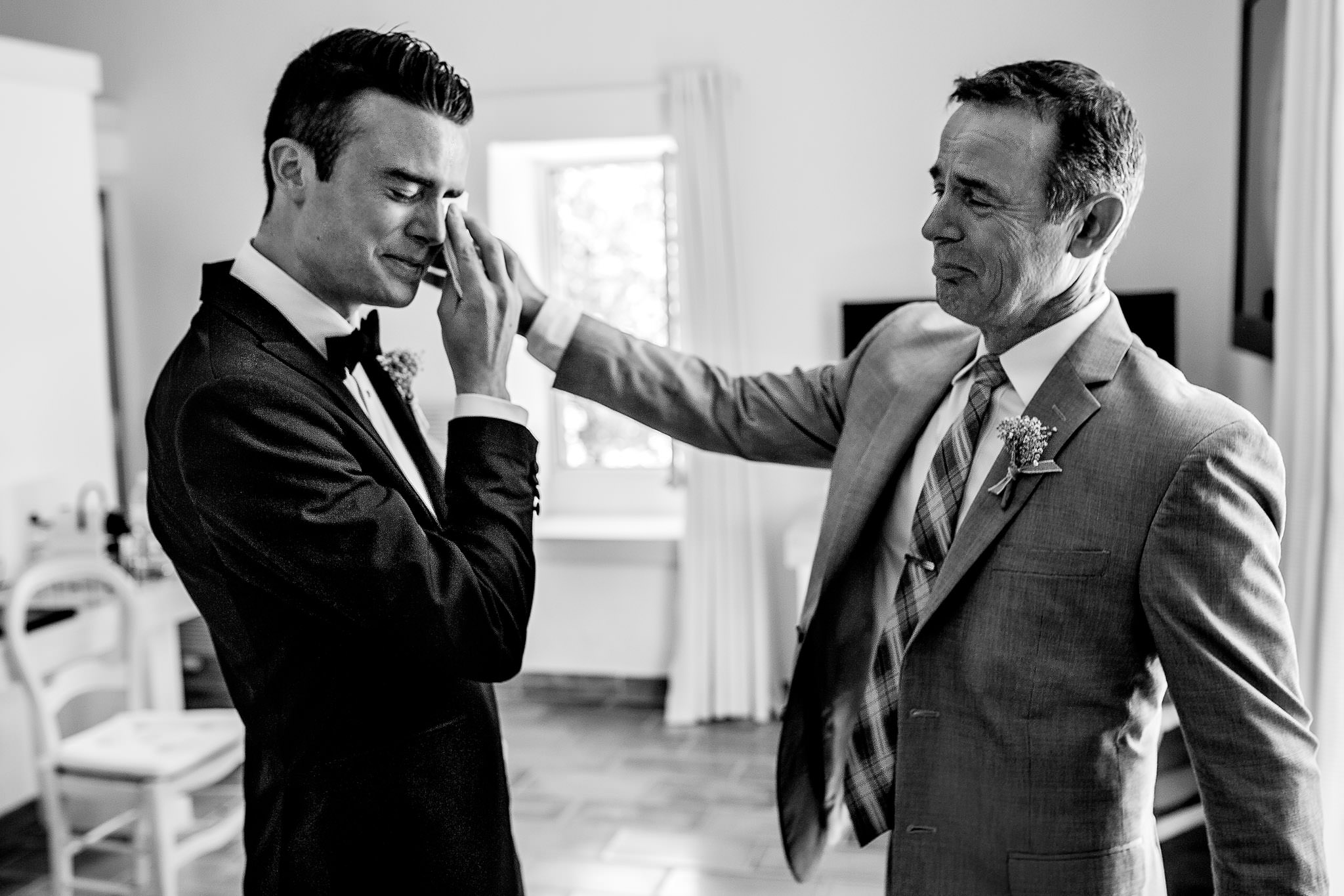 Groom crying with father in Cirque de Navacelles outside Montpellier France