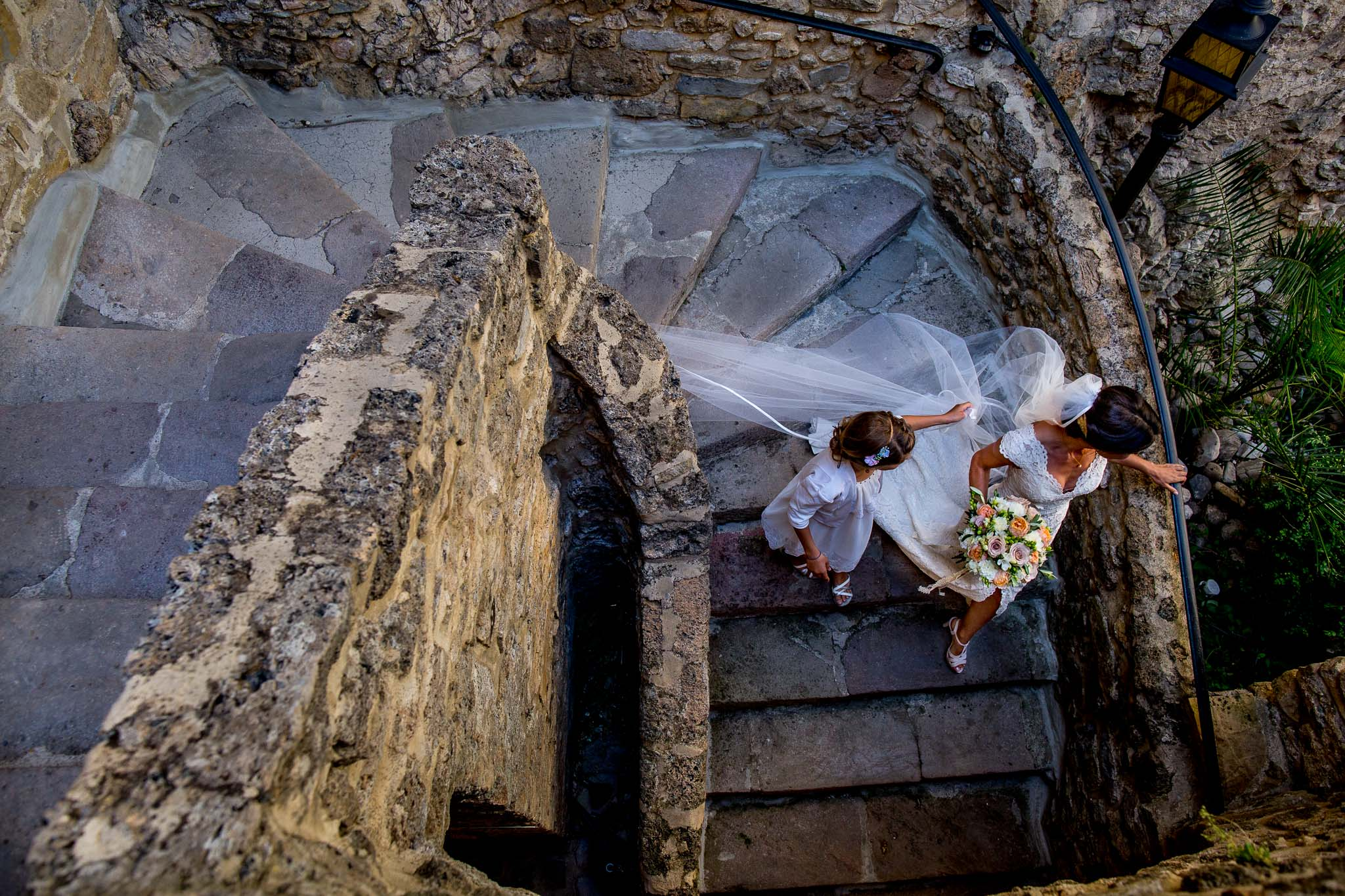Bride walking down staircase in Cirque de Navacelles outside Montpellier France