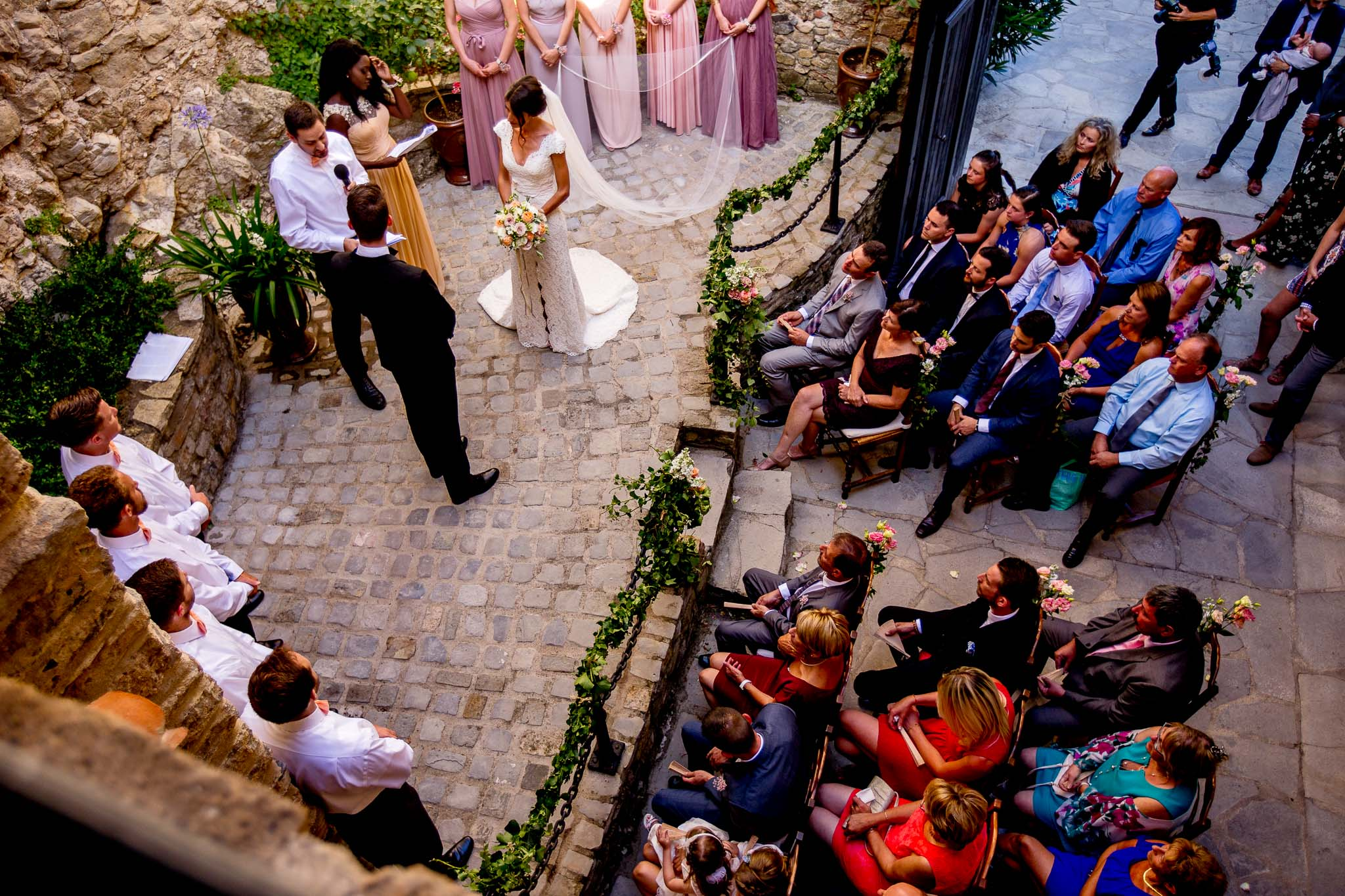 Wide angle view of chateau wedding ceremony in Cirque de Navacelles outside Montpellier France
