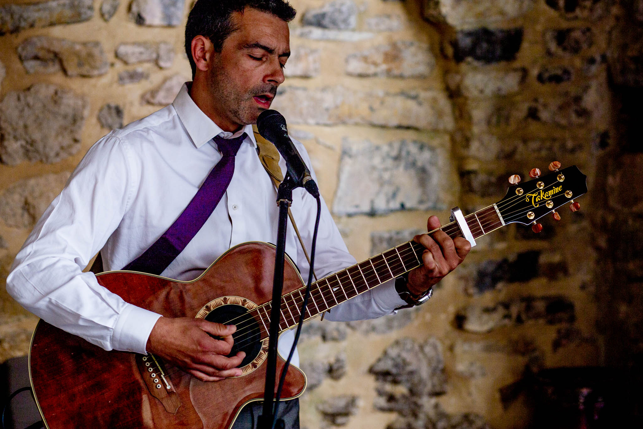 Best man singing during wedding ceremony in Cirque de Navacelles outside Montpellier France