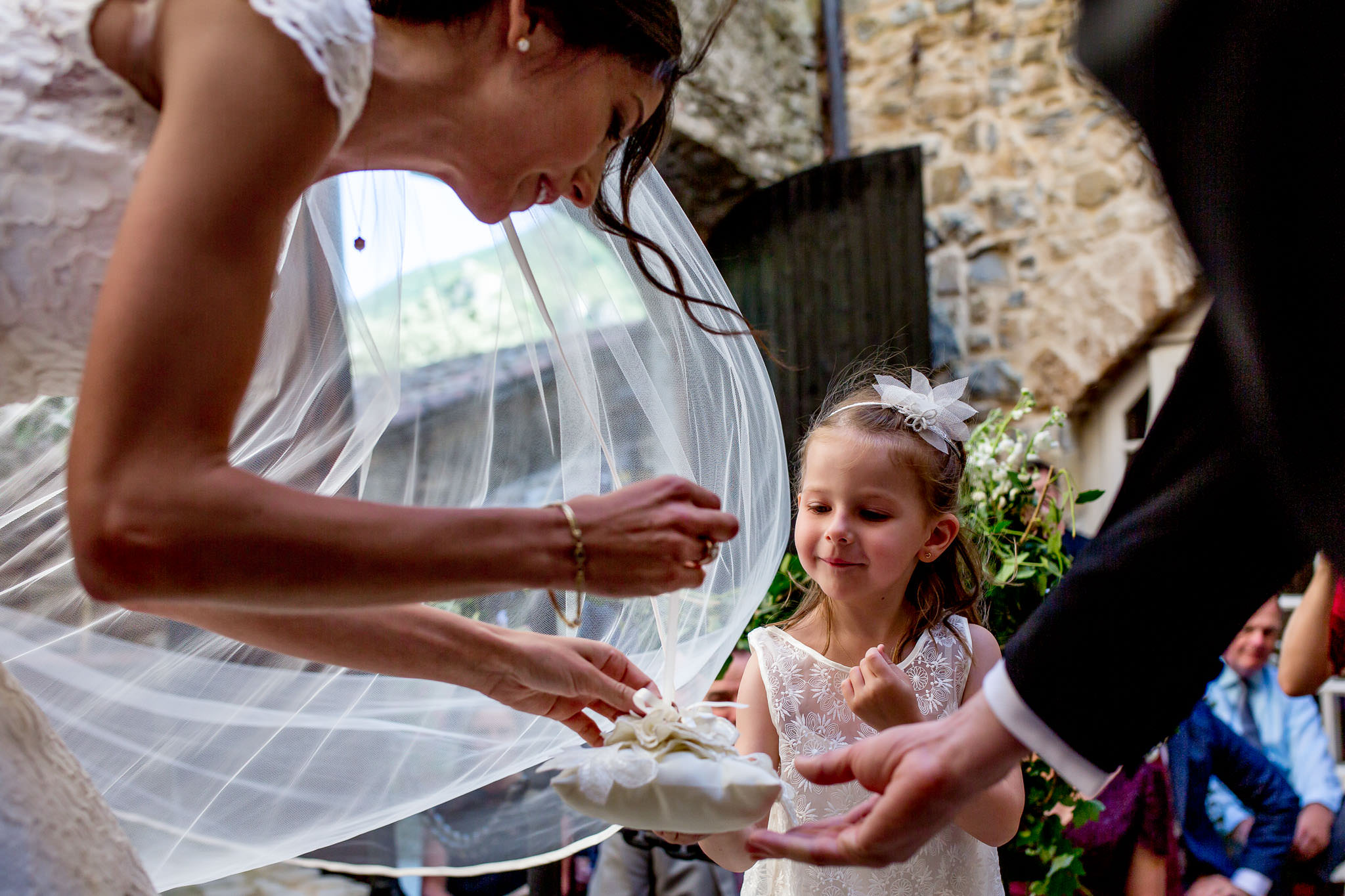 Bride with wedding rings and small French child in wedding ceremony in Cirque de Navacelles outside Montpellier France