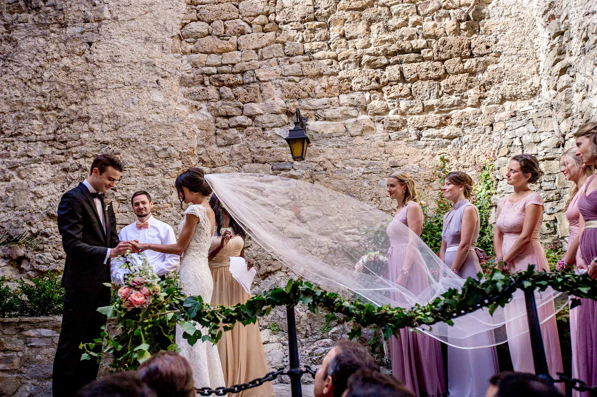 Exchanging rings during wedding ceremony in Cirque de Navacelles outside Montpellier France