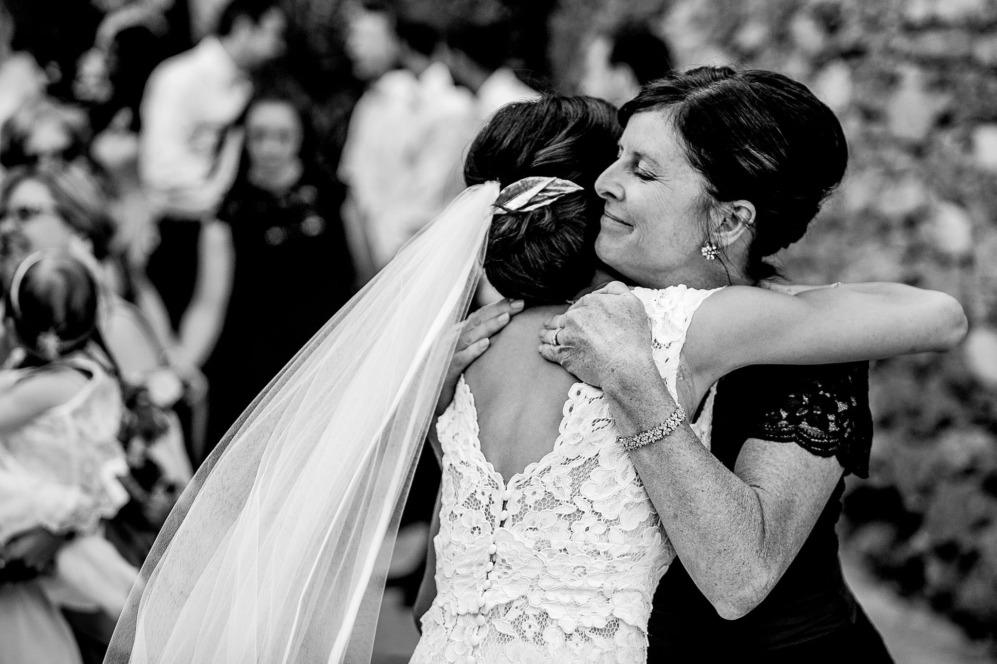 Emotional hugging at chateau wedding in Cirque de Navacelles outside Montpellier France