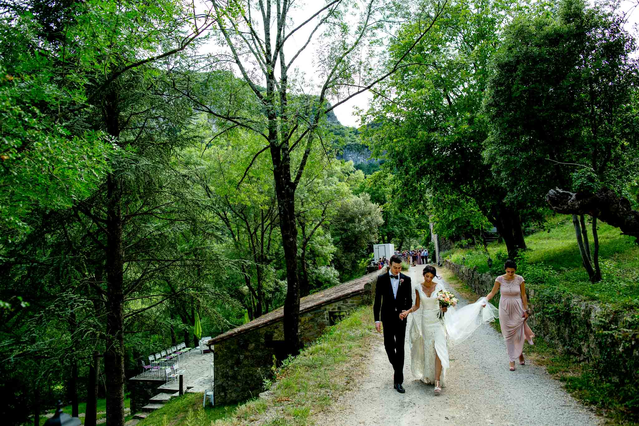 Bride and Groom walkin at chateau wedding in Cirque de Navacelles outside Montpellier France