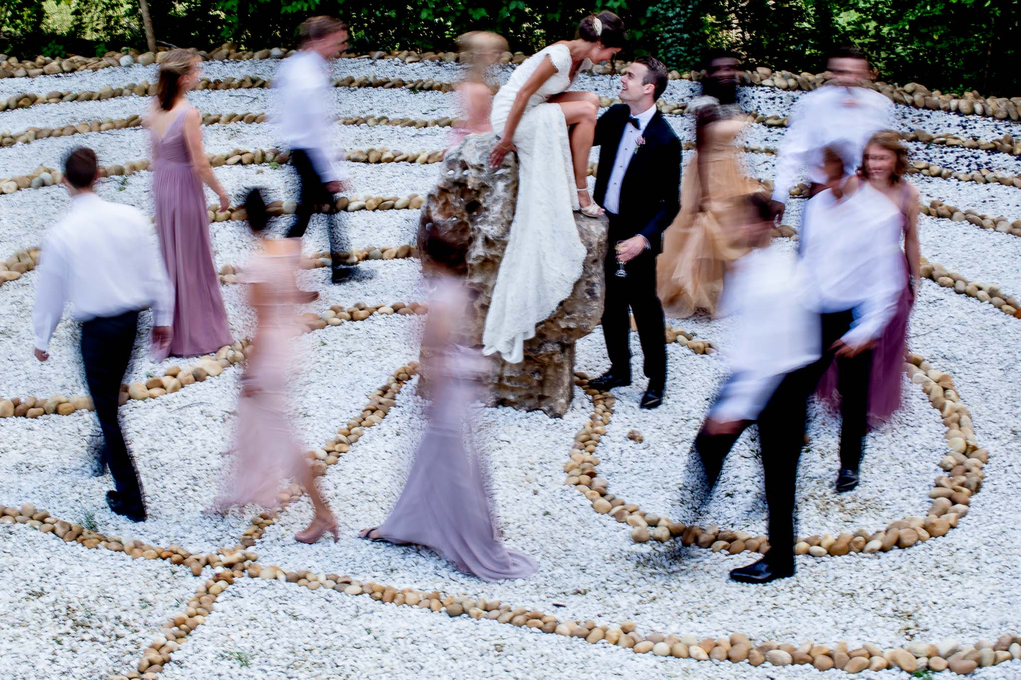 Bride and Groom laughing with bridal party at chateau wedding in Cirque de Navacelles outside Montpellier France