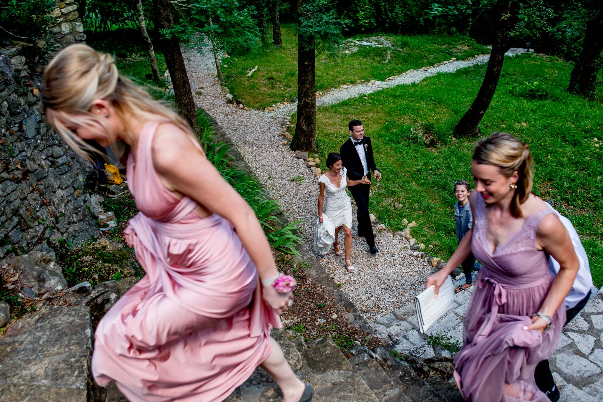 Bride and groom walking at chateau wedding in Cirque de Navacelles outside Montpellier France