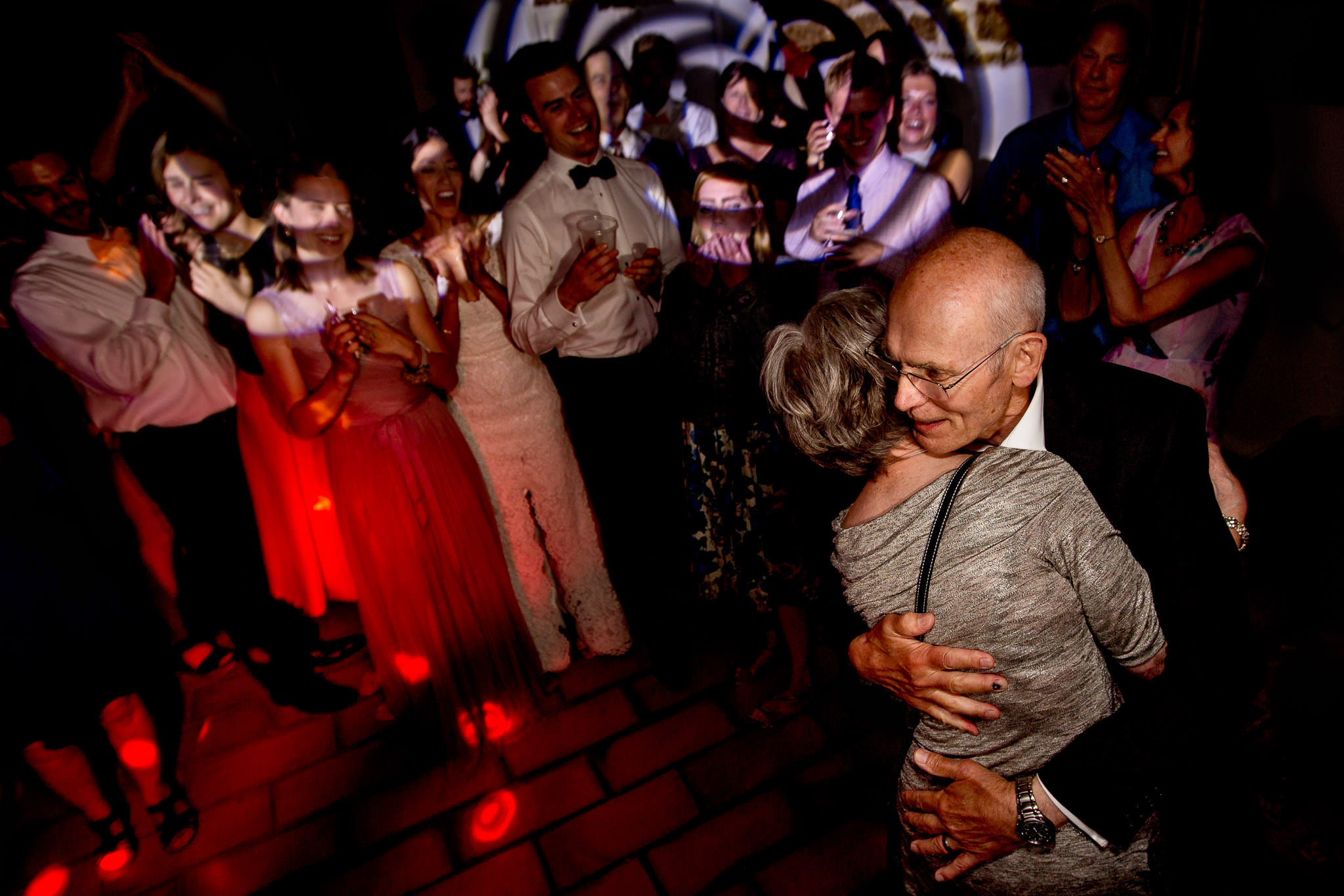 Father of bride dancing with mother Bride at chateau wedding in Cirque de Navacelles outside Montpellier France