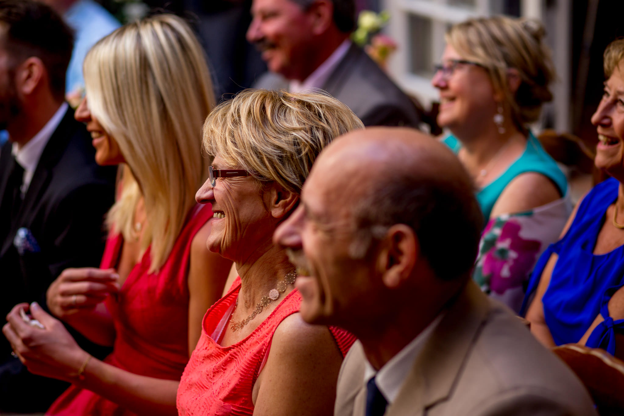 Guests laughing at wedding ceremony in Cirque de Navacelles outside Montpellier France