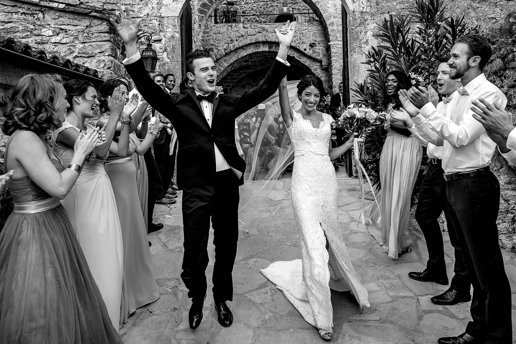 Bride and Groom ecstatic exit at chateau wedding near Montpellier in France