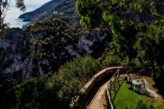Bride and Groom on Belvedere looking out over Ravello from Villa Cimbrone along Amalfi Coast Italy