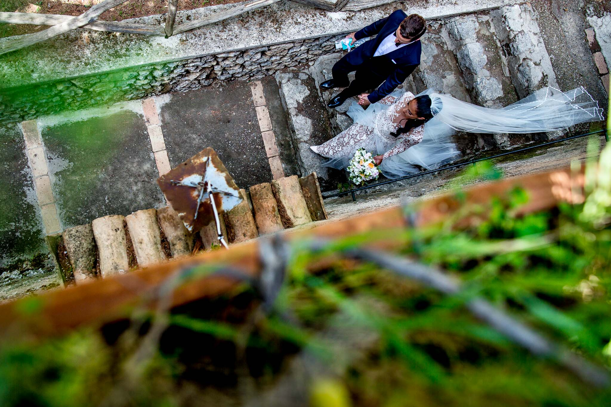 Bride and Groom walking through garden at Villa Cimbrone on Amalfi Coast in Italy