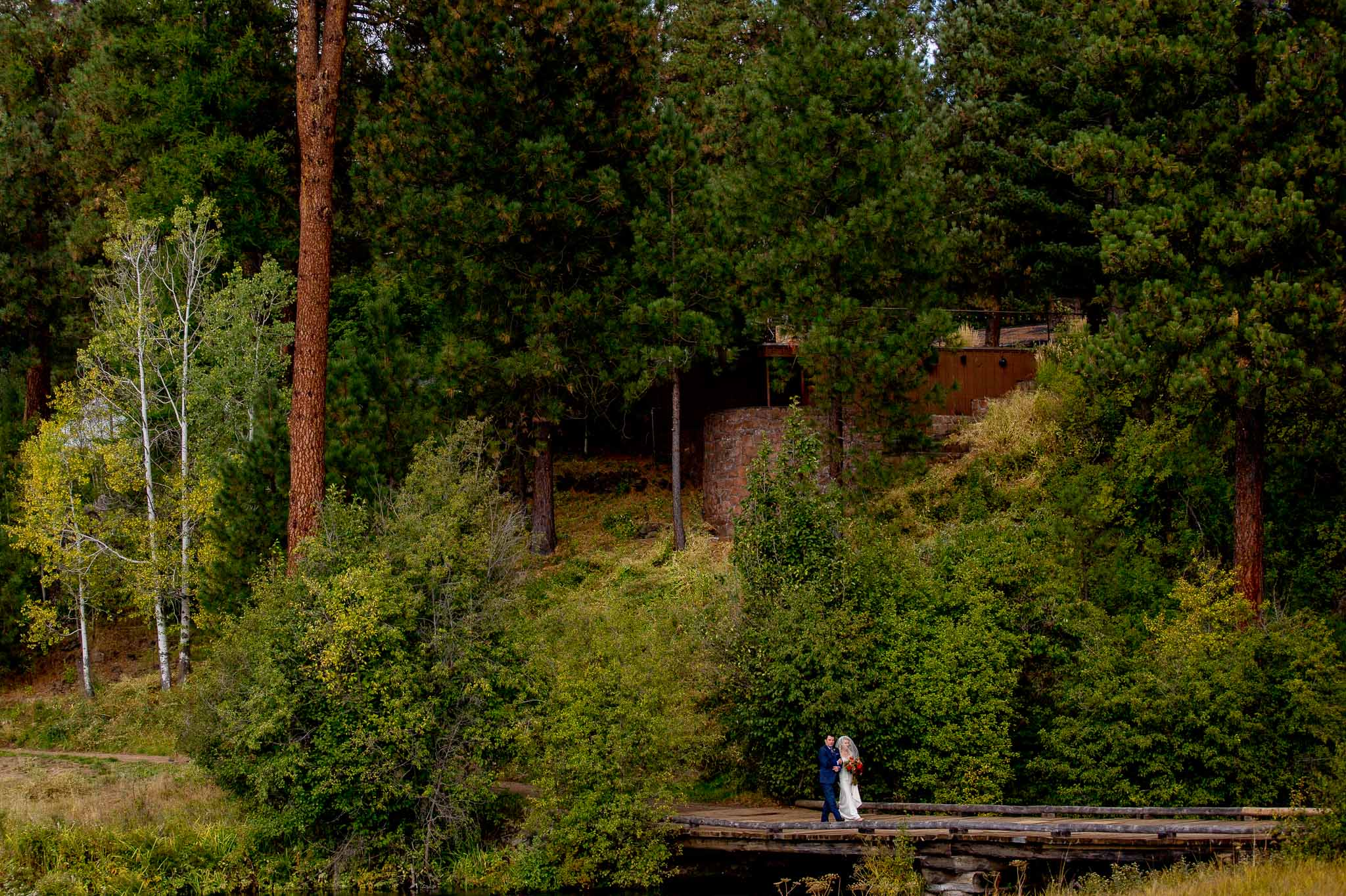 Bride walking into ceremony at House on Metolious in Sisters Oregon