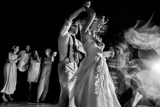 ISPWP award winning wedding photo by JOS studios bride and groom dancing crazy