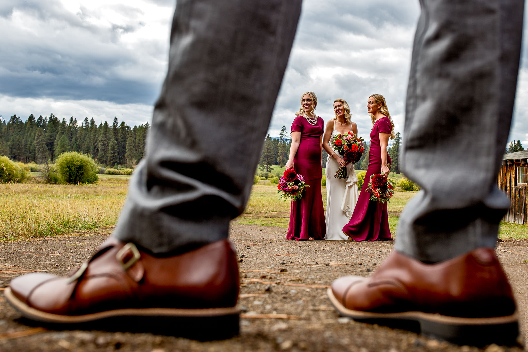 Bridesmaids captured through grooms shoes