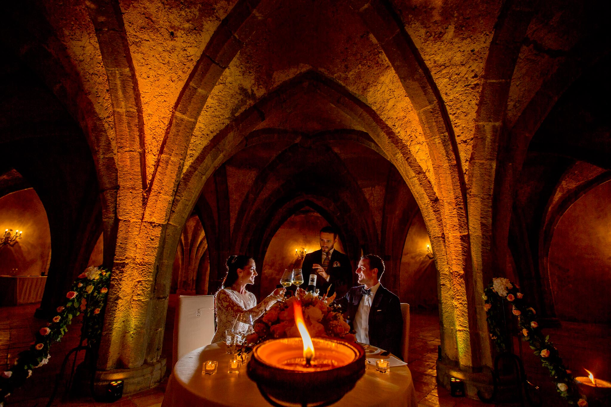 Bride and Groom toasting to wine in Crypt at Villa Cimbrone in Amalfi Italy