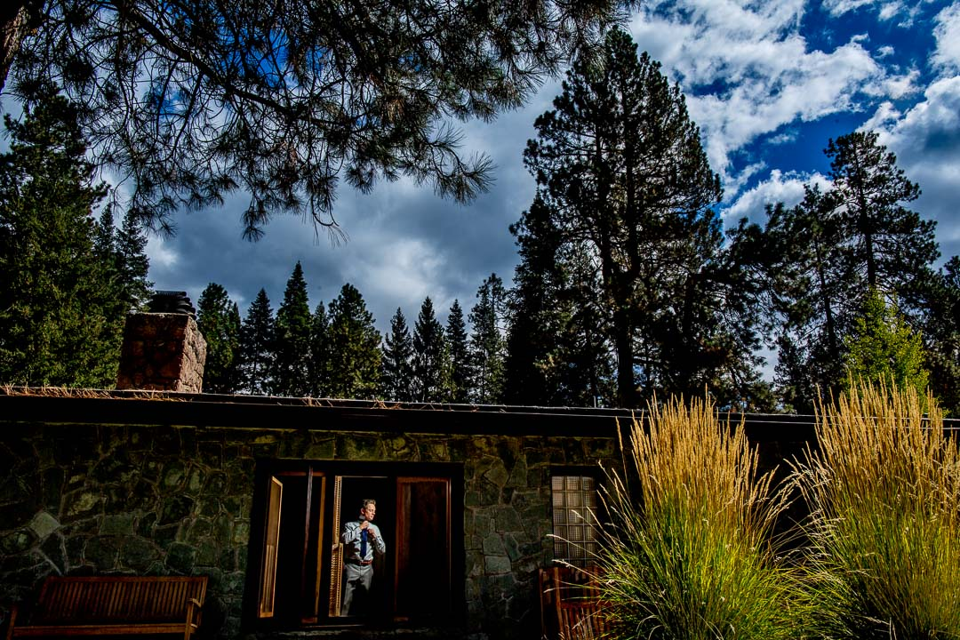 Groom getting ready at House on Metolius Central Oregon Wedding