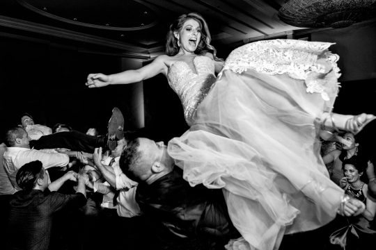 ISPWP award winning photo of bride flying at reception